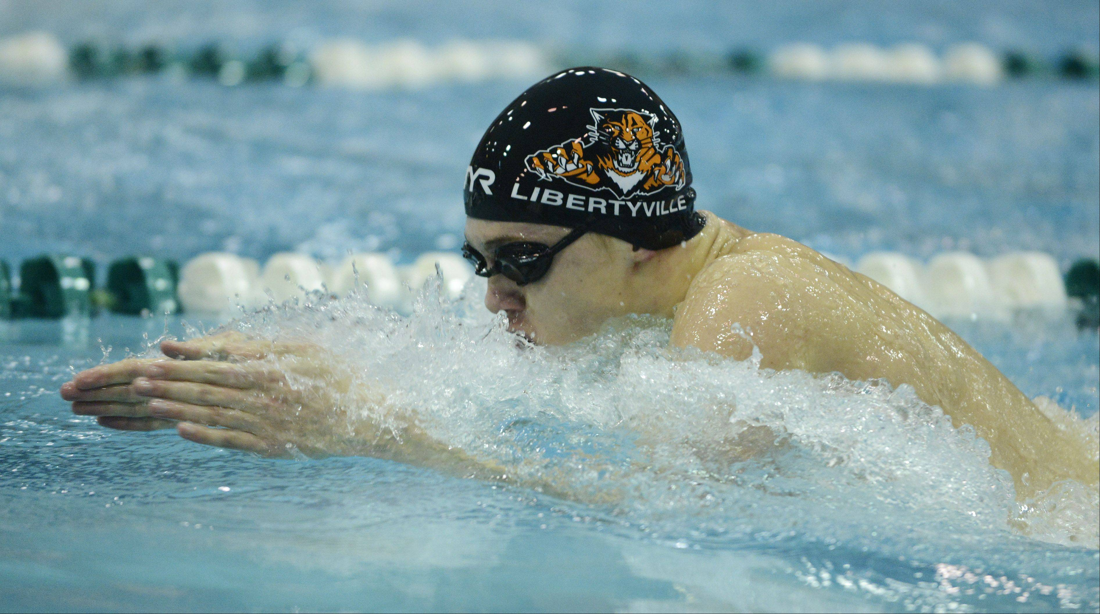 Libertyville's Atticus Rush swims breast stroke in the 200-yard medley relay during the boys state swimming finals at New Trier High School in Winnetka Saturday.