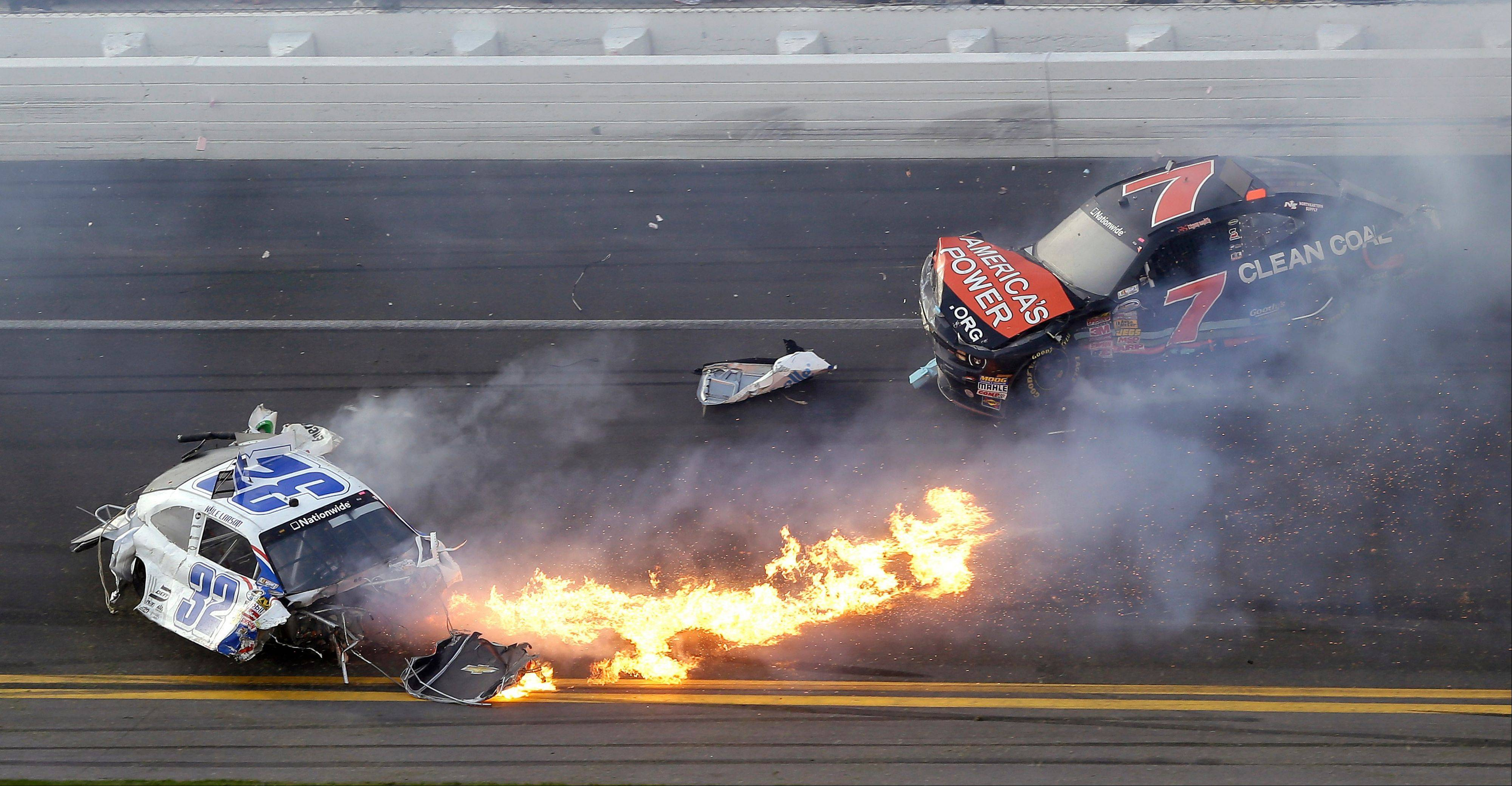 Kyle Larson, left, slides to a stop near Regan Smith (7) after a wreck at the conclusion of the NASCAR Nationwide Series auto race Saturday, Feb. 23, 2013, at Daytona International Speedway in Daytona Beach, Fla.
