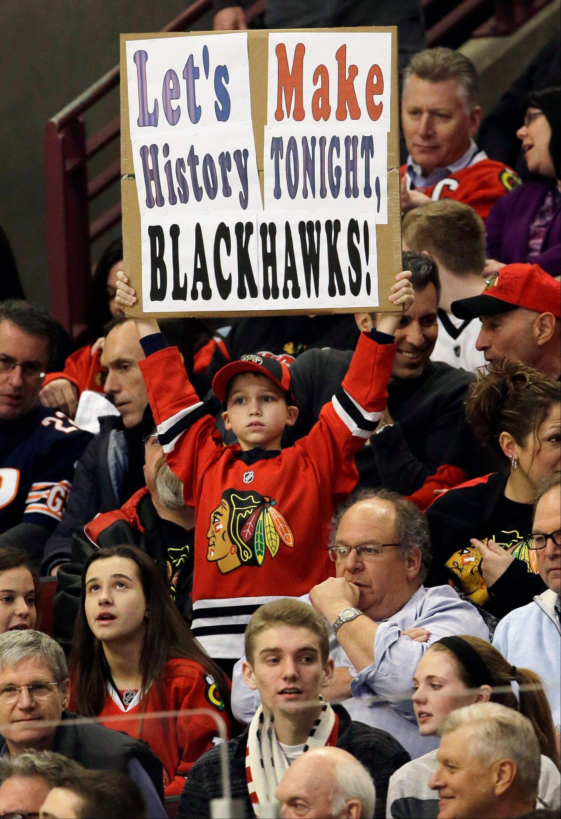A Chicago Blackhawks fan holds a sign during the first period.