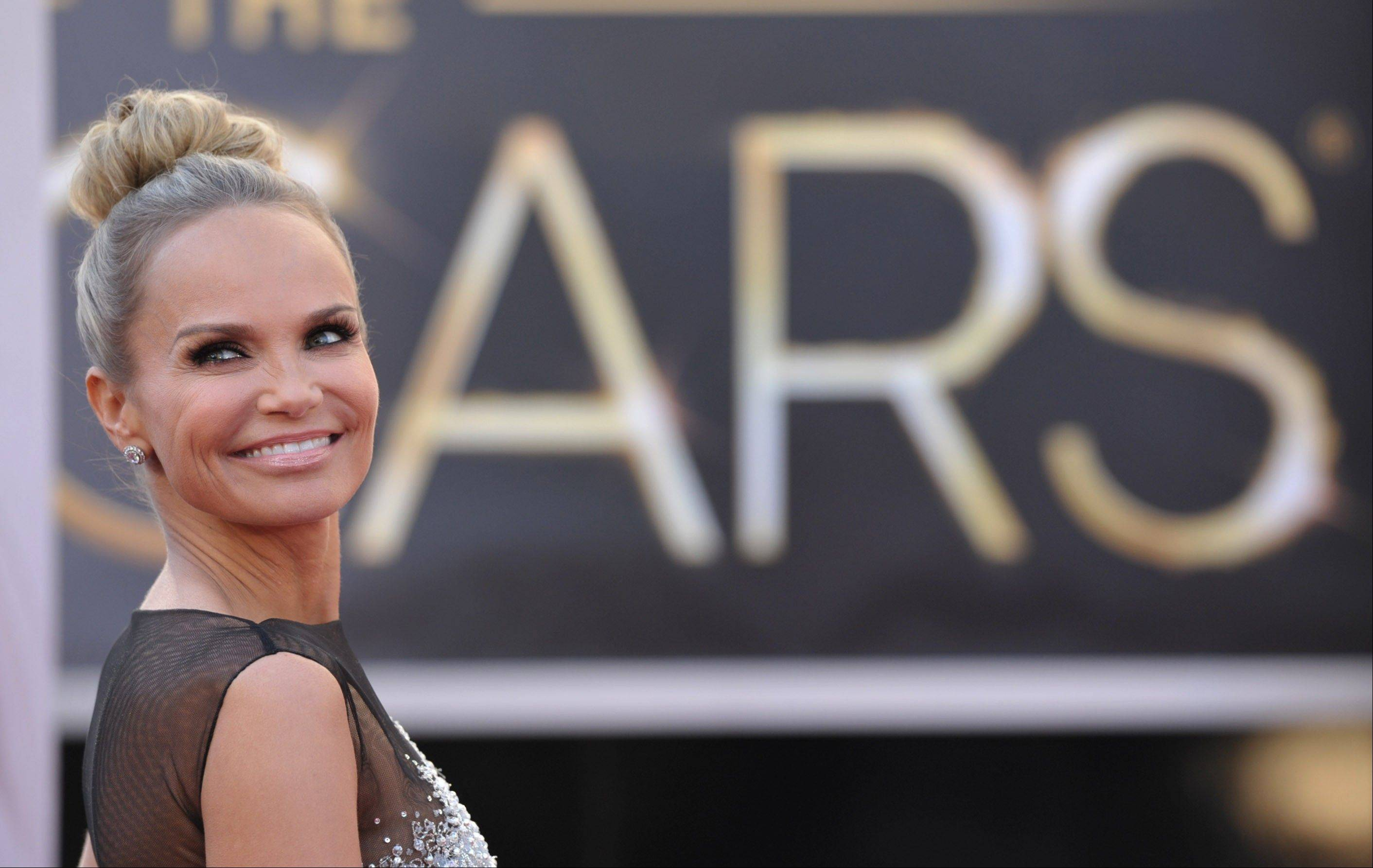 Actress Kristin Chenoweth arrives at the 85th Academy Awards at the Dolby Theatre on Sunday in Los Angeles.