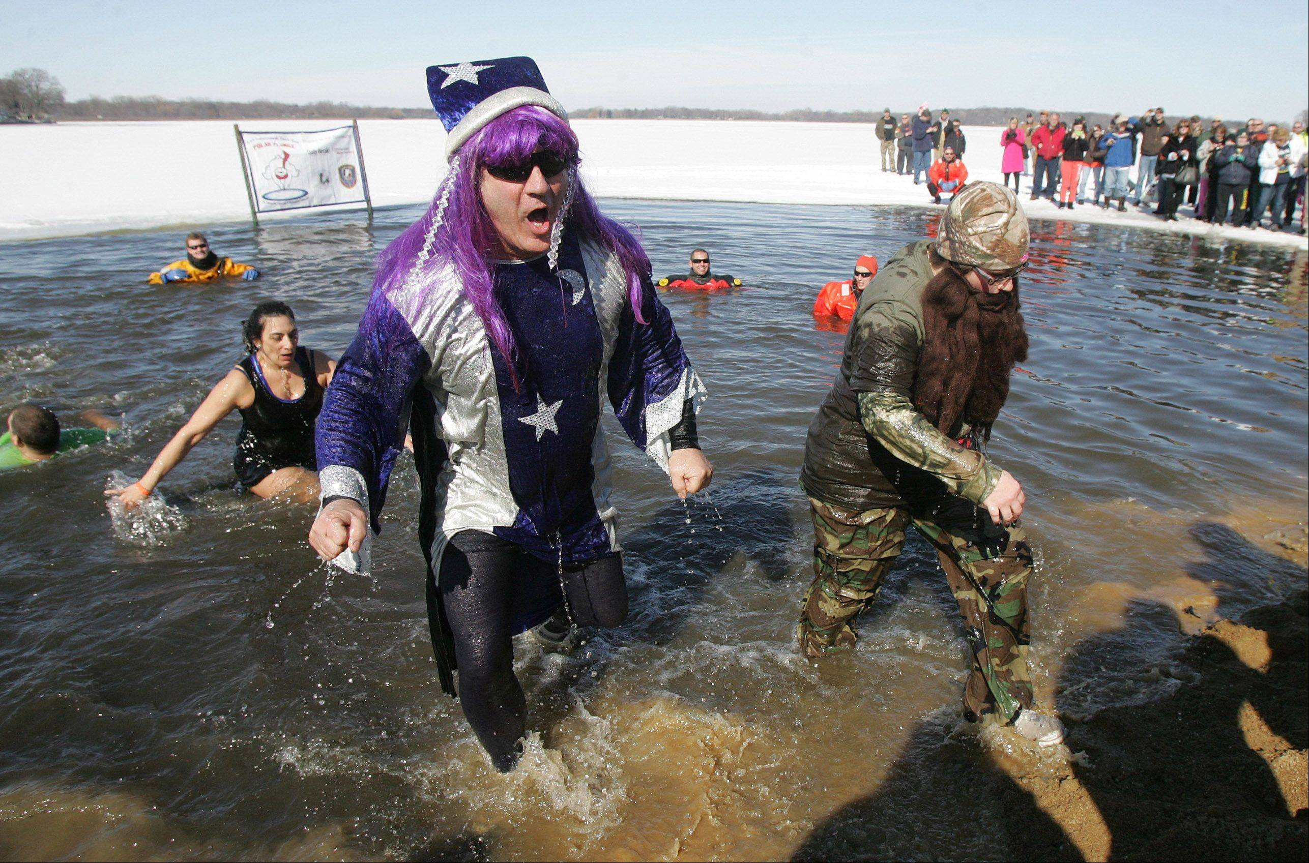 Tom Muehlfelder, left, and Amy Serafin, both of Fox Lake, exit the frigid water during the annual Fox Lake Polar Plunge Sunday at Lakefront Park. The funds raised will benefit Special Olympics Illinois Northeastern/Area 13, which serves athletes with physical and intellectual disabilities in Lake and McHenry counties.