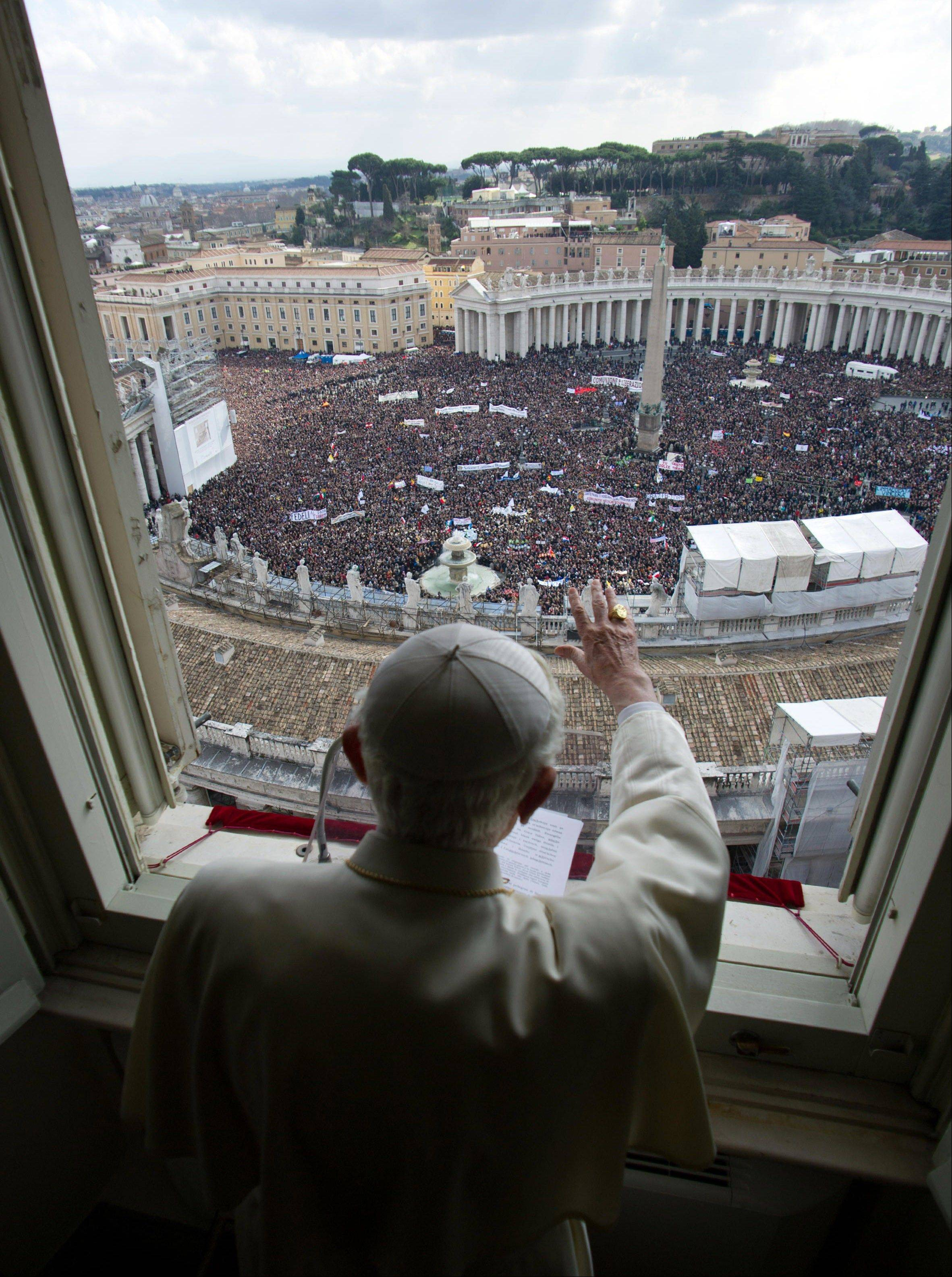 In this photo provided by the Vatican newspaper L'Osservatore Romano, Pope Benedict XVI delivers his blessing during his last Angelus noon prayer, from the window of his studio overlooking St. Peter's Square, at the Vatican, Sunday. Benedict XVI gave his pontificate's final Sunday blessing from his studio window to the cheers of tens of thousands of people packing St. Peter's Square.