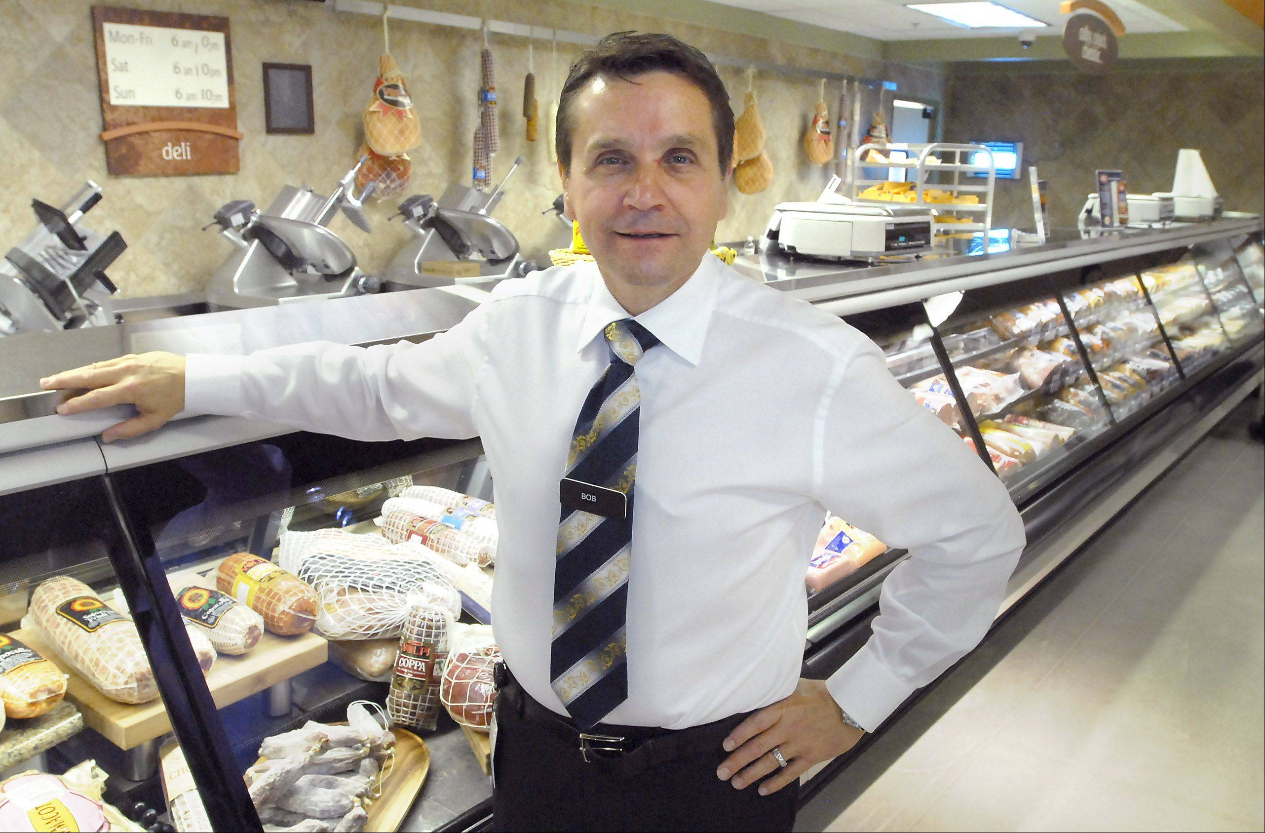 CEO Bob Mariano of Inverness stands at the deli counter of Mariano's Fresh Market in Arlington Heights.
