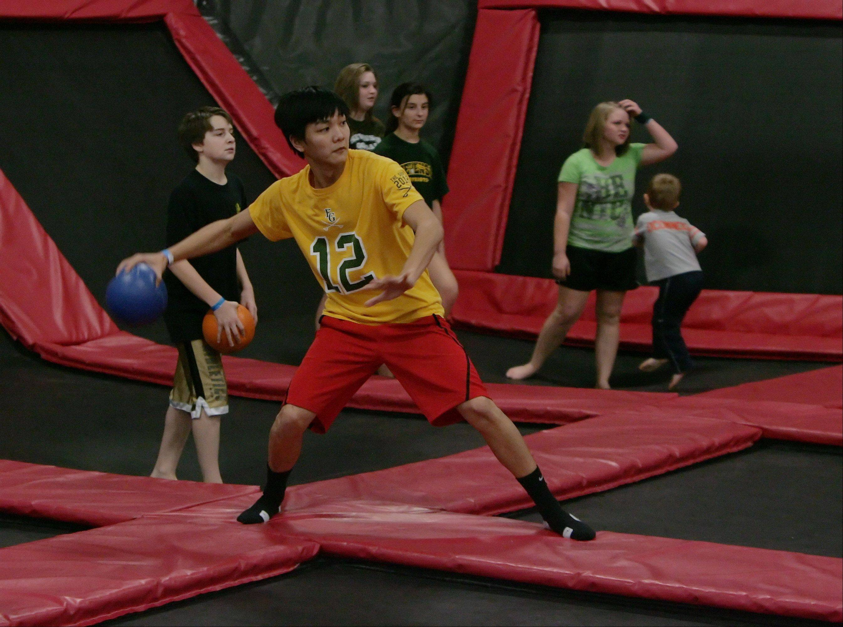 Kevin Huynh, 16, of Des Plaines, prepares to throw the ball in extreme dodgeball at Xtreme Trampolines in Buffalo Grove. The entertainment center offers an active alternative for kids in the suburbs.