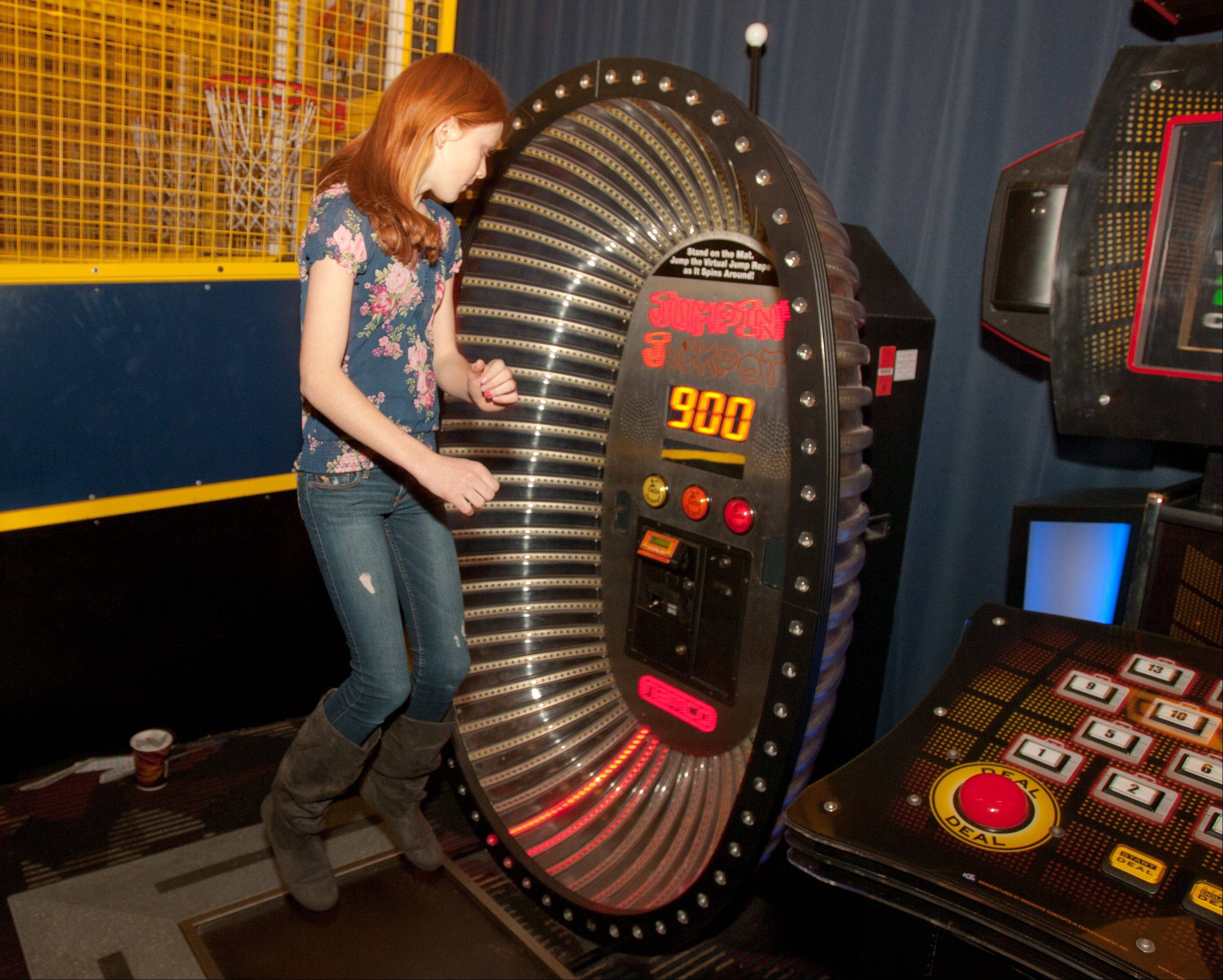 Lauren Gould, 13, of Elmhurst plays Jumpin' Jackpot, a jump-rope simulation video game at Dave and Buster's in Addison.