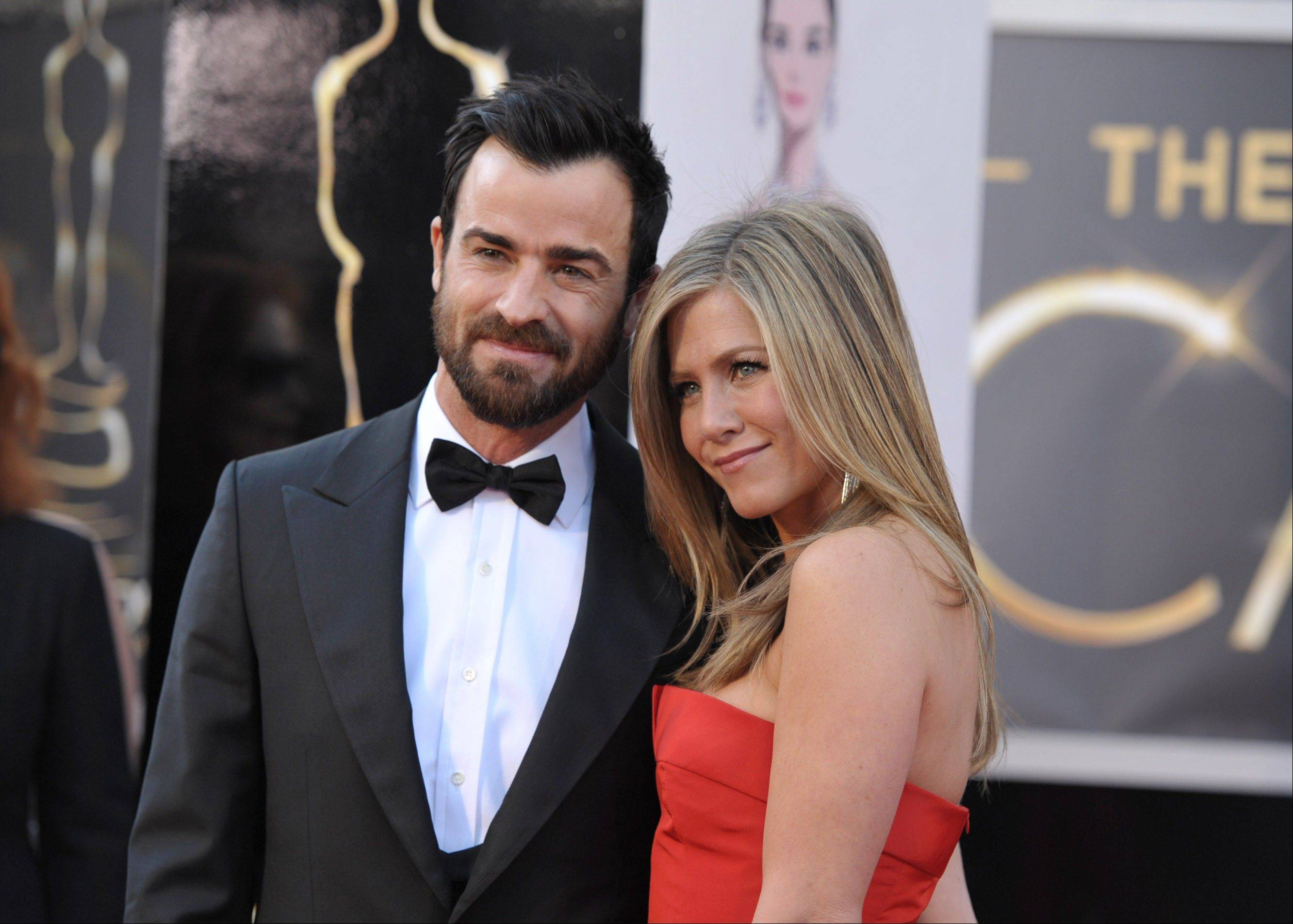 Justin Theroux and Jennifer Aniston arrive at the Oscars at the Dolby Theatre on Sunday in Los Angeles.