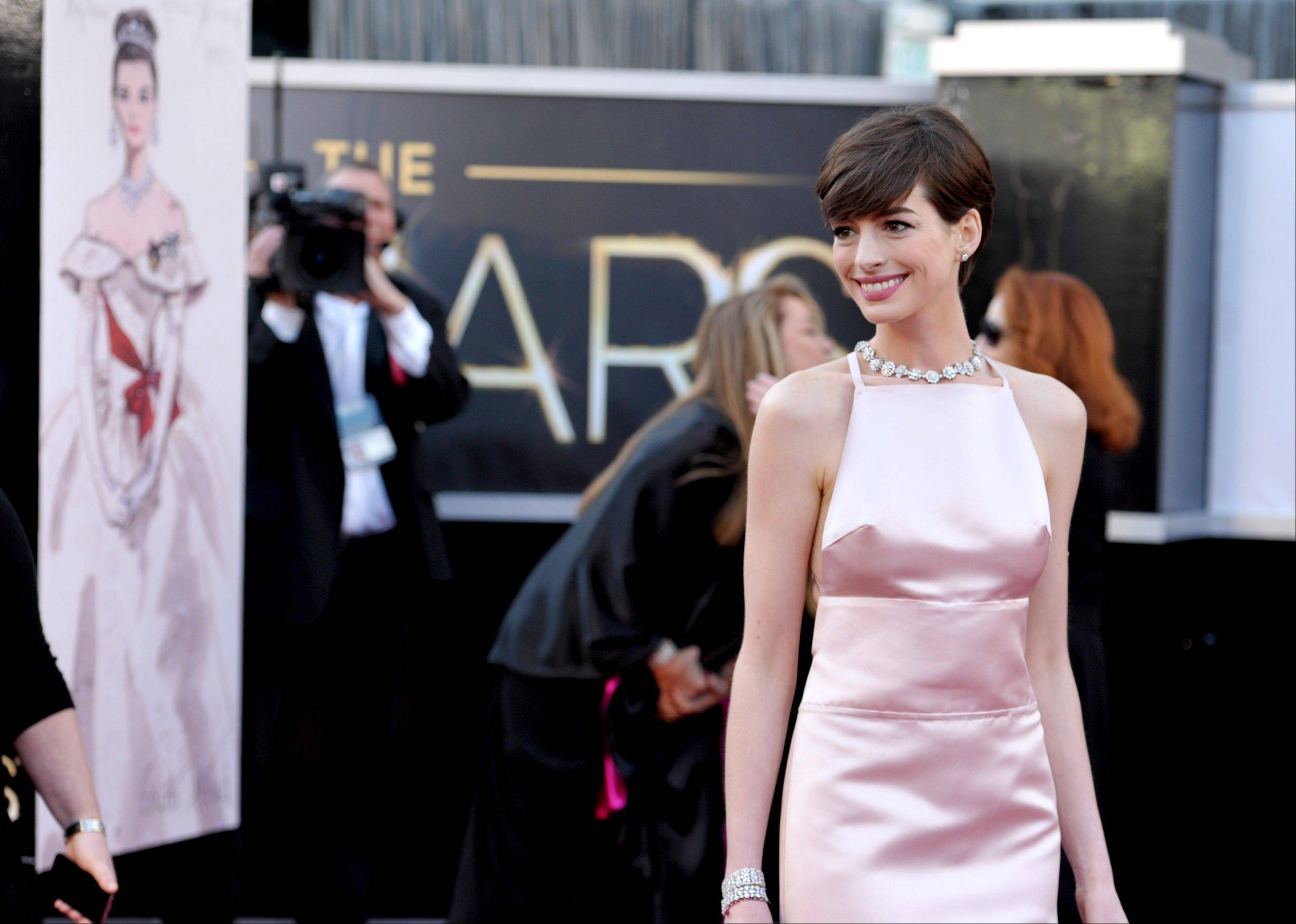 Actress Anne Hathaway arrives at the Oscars at the Dolby Theatre on Sunday in Los Angeles.