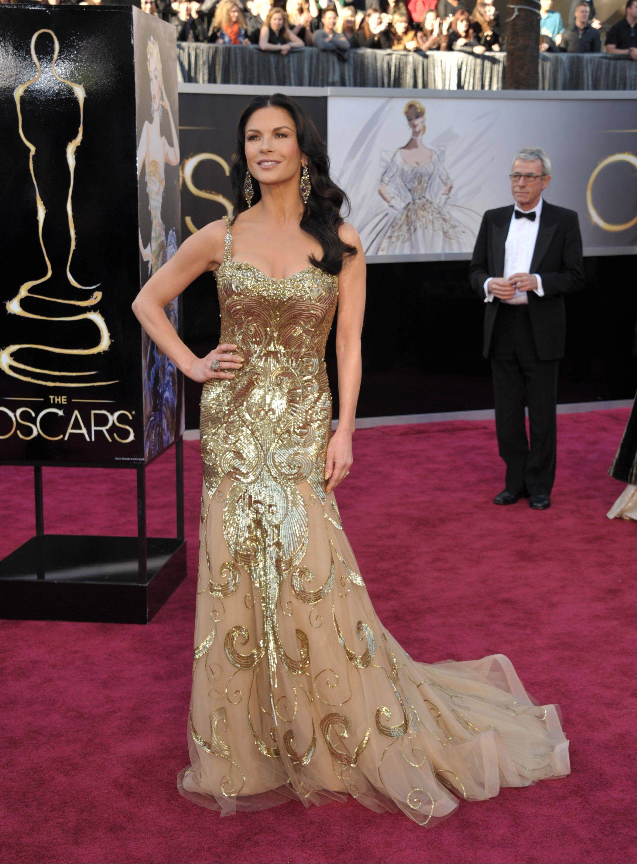 Actress Catherine Zeta-Jones arrives at the Oscars at the Dolby Theatre on Sunday in Los Angeles.