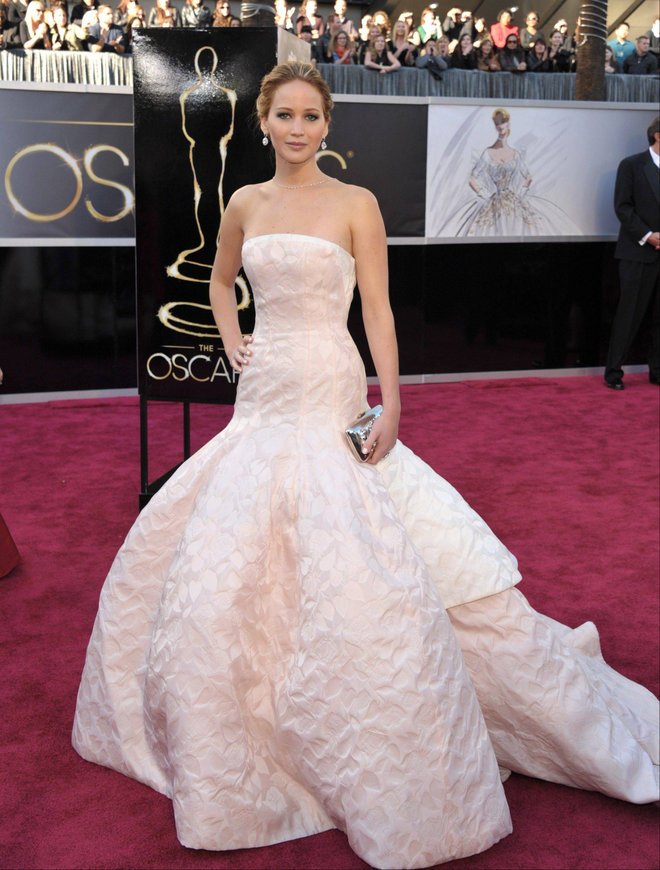 Actress Jennifer Lawrence arrives at the Oscars at the Dolby Theatre on Sunday in Los Angeles.