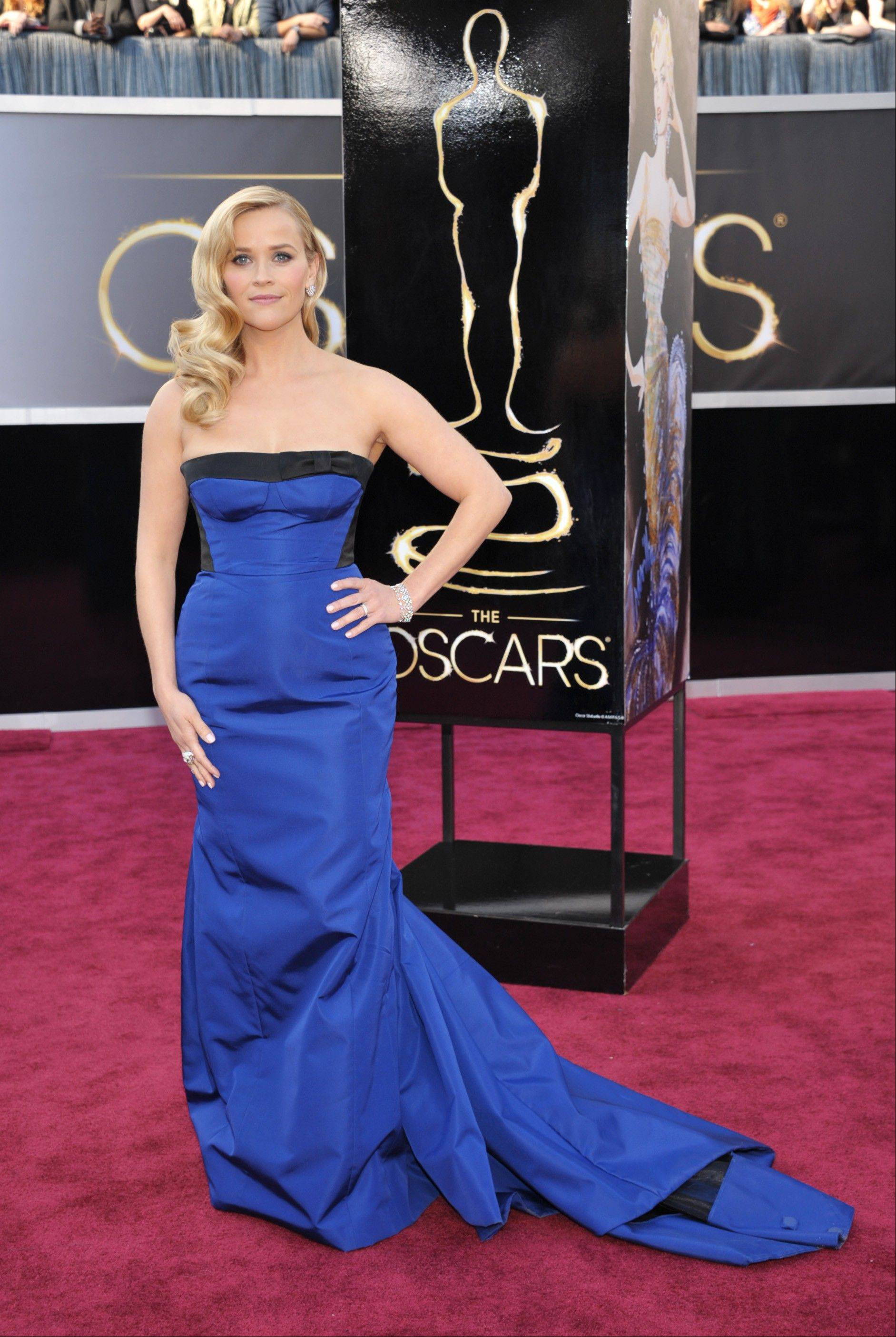 Reese Witherspoon arrives at the 85th Academy Awards at the Dolby Theatre on Sunday in Los Angeles.