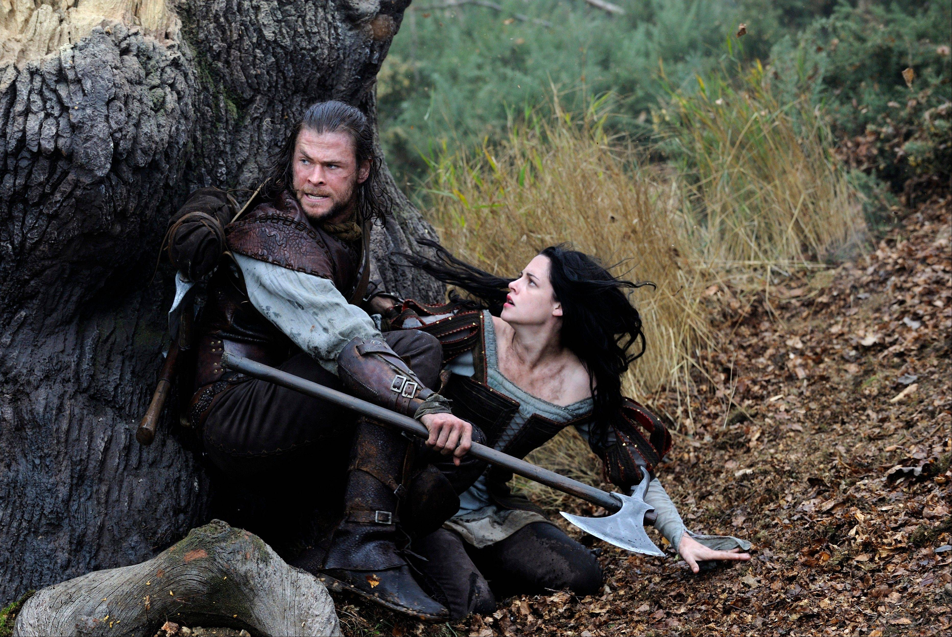 "Chris Hemsworth and Kristen Stewart flee from menacing visual effects in ""Snow White and the Huntsman."" Carol Stream native Andy Arnett served as director of animation on the Oscar-nominated movie."