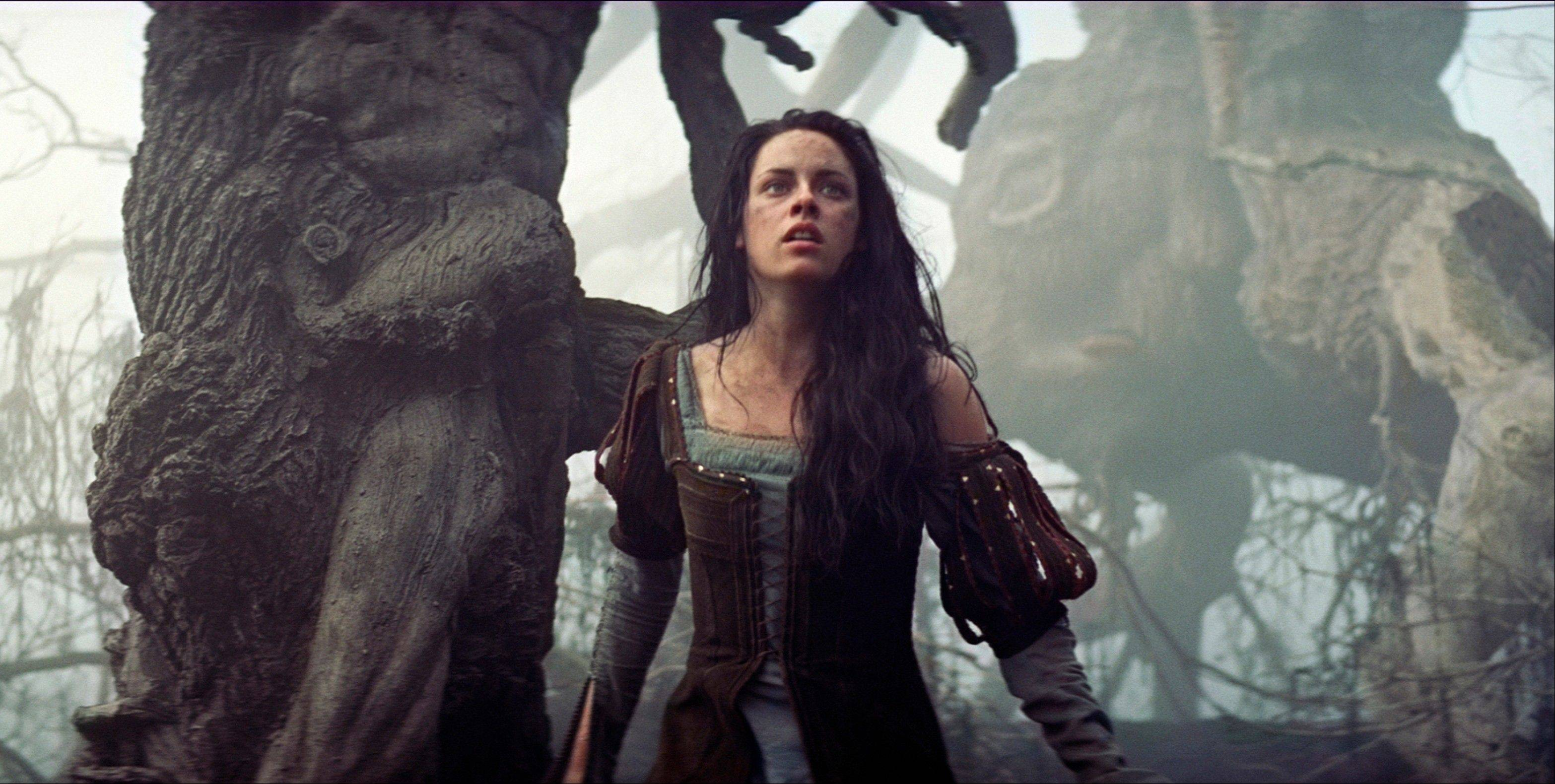 "Kristen Stewart flees from menacing visual effects in ""Snow White and the Huntsman."" Carol Stream native Andy Arnett served as director of animation on the Oscar-nominated movie."
