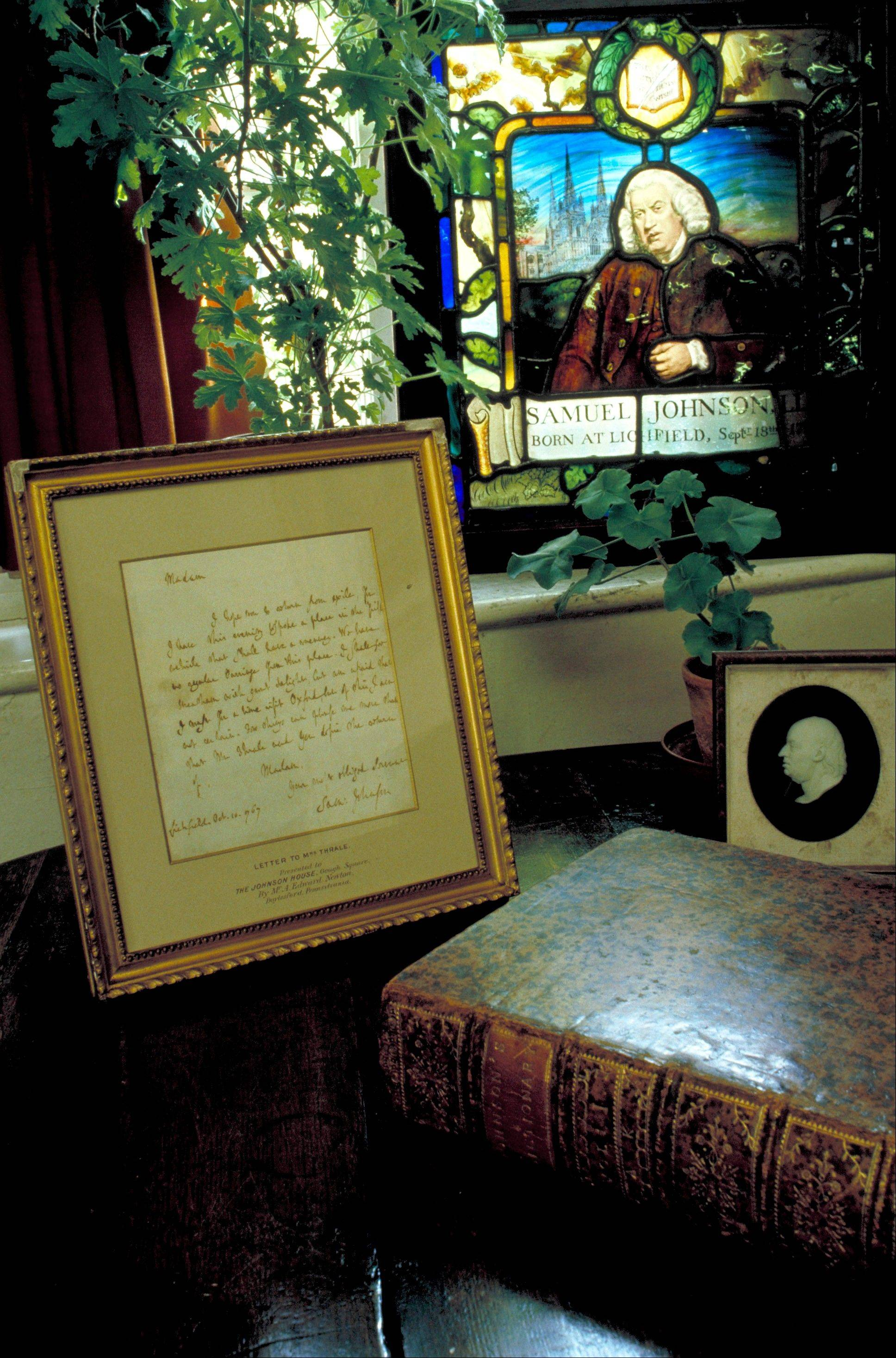 A letter written by Samuel Johnson and a copy of the dictionary he wrote, which was published in 1755, are kept beneath a stained glass plaque at Dr. Johnson's House, a small museum in the 300-year-old townhouse where he lived in London.