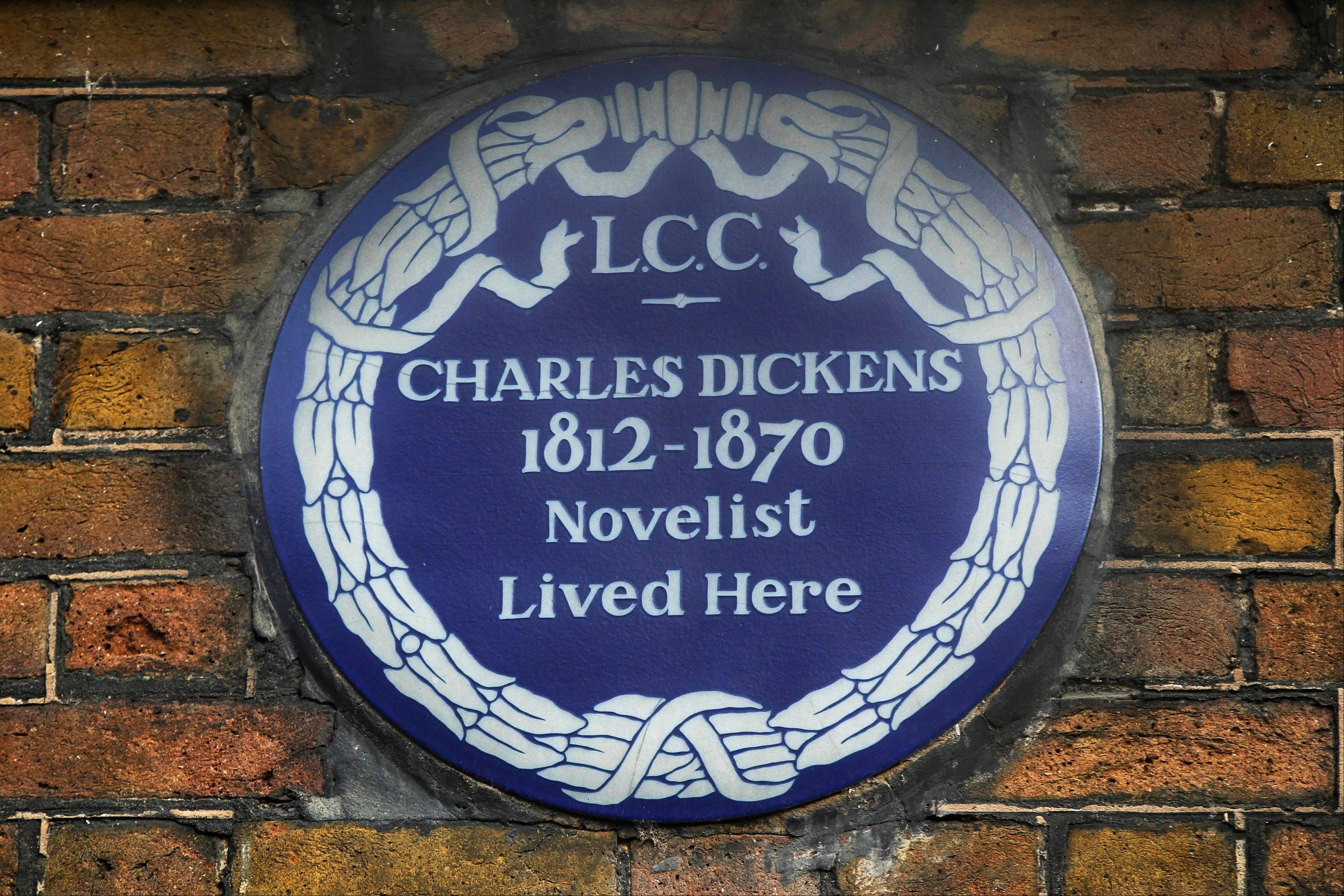 A blue plaque is on the exterior of Charles Dickens' home, part of the Charles Dickens Museum in London. For years, the four-story brick row house where the author lived with his young family was a dusty and slightly neglected museum, a mecca for Dickens scholars, but overlooked by most visitors.