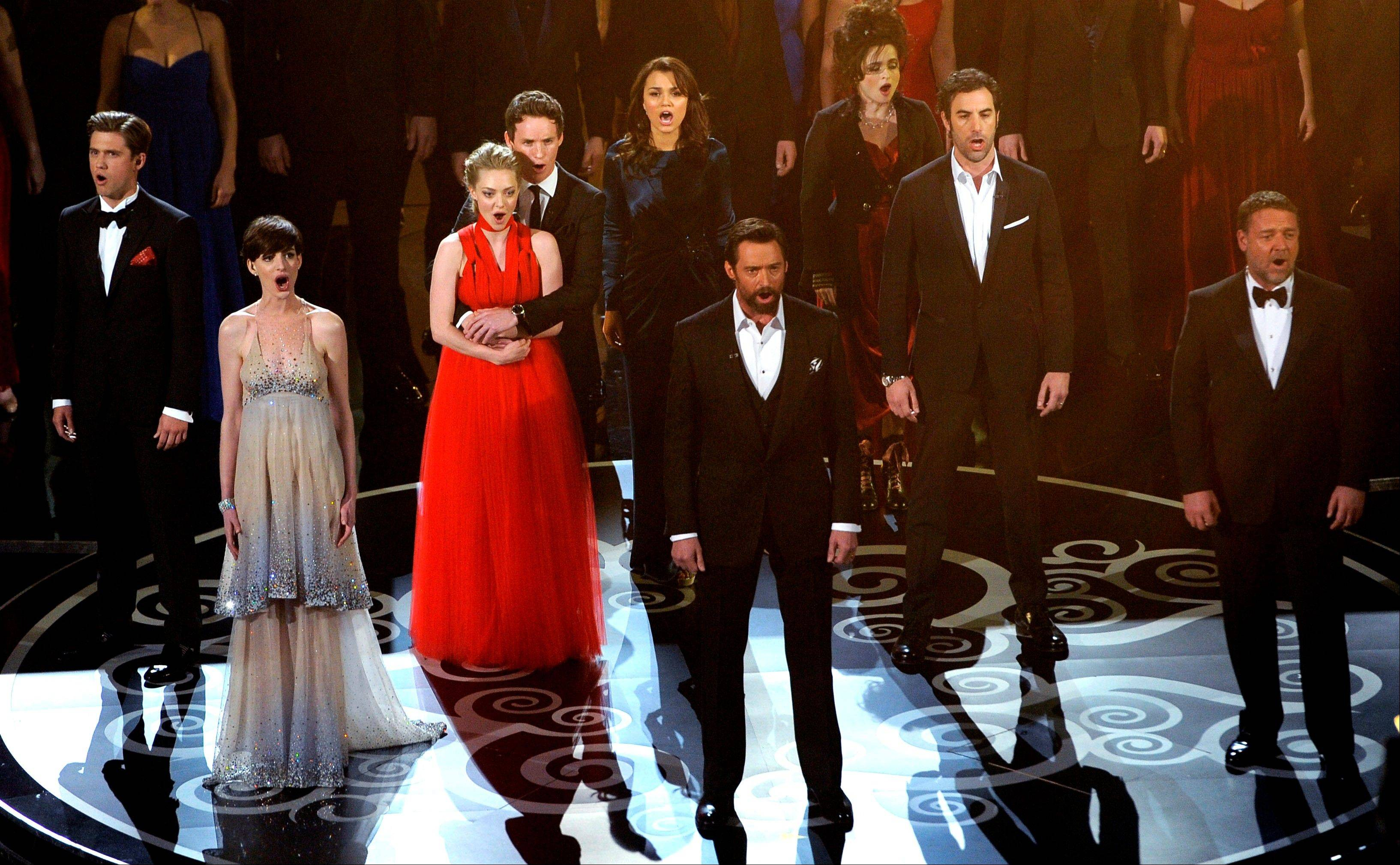 """Les Miserables"" cast members Aaron Tveit, left, Anne Hathaway, Amanda Seyfried, Eddie Redmayne, Samantha Barks, Hugh Jackman, Helena Bonham Carter, Sacha Baron Cohen and Russell Crowe perform at Sunday's Oscars."