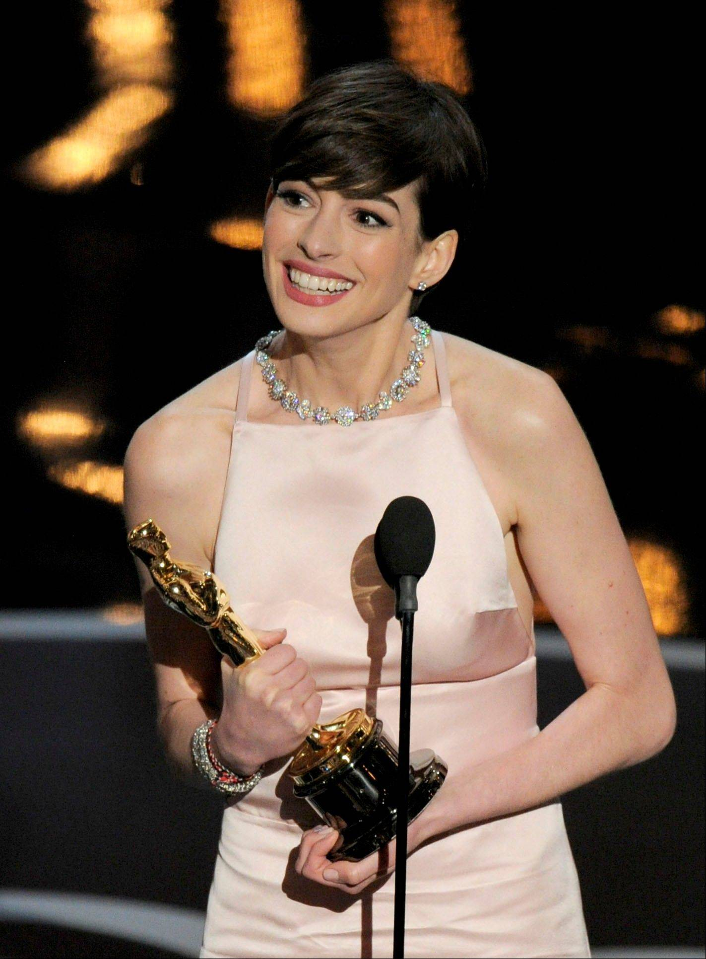 "Anne Hathaway accepts the award for best actress in a supporting role for ""Les Miserables"" during Sunday's Oscars."