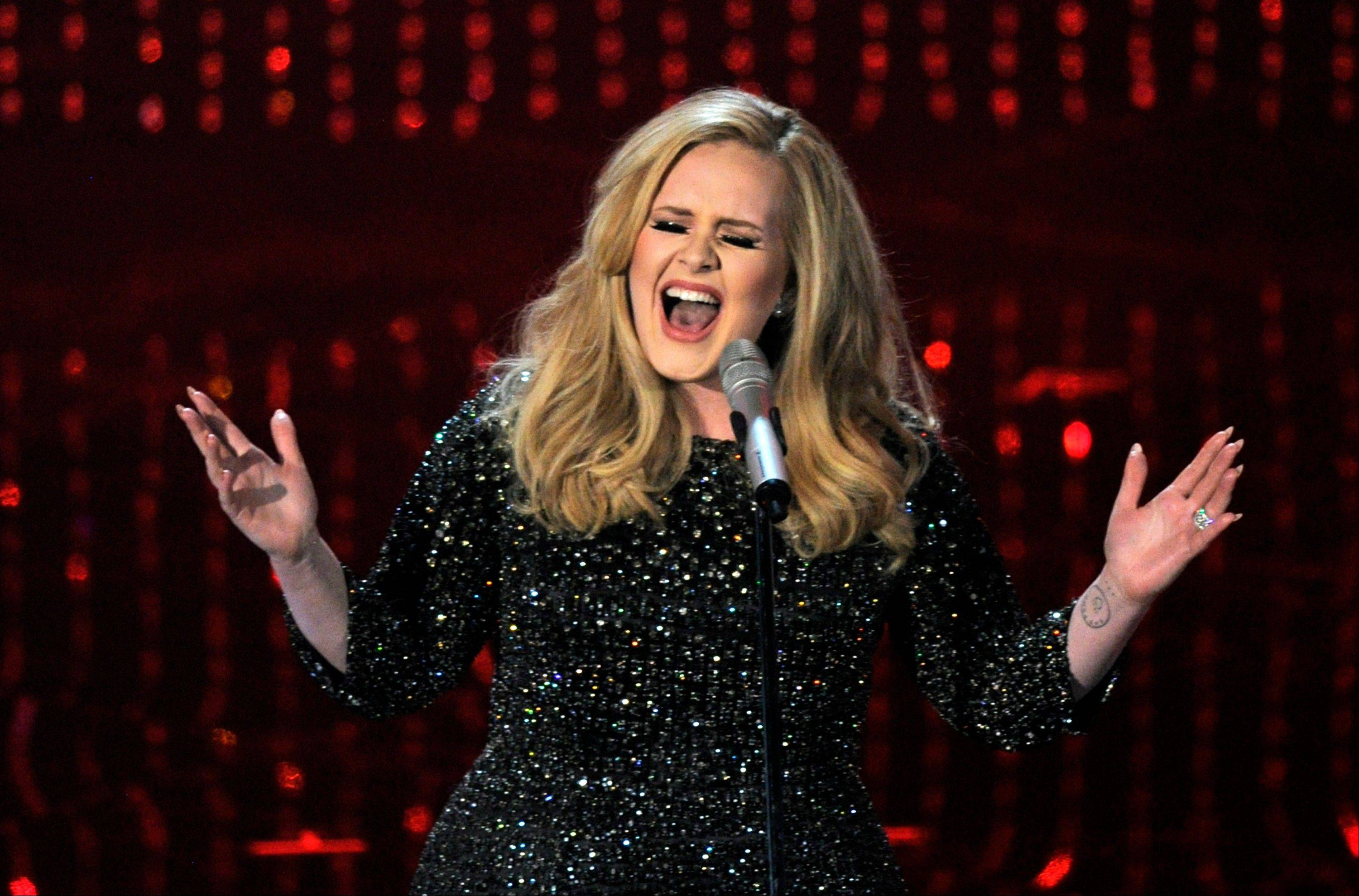 "Singer Adele performs the theme from ""Skyfall"" during Sunday's Oscars. Adele and Paul Epworth won the best original song award for the same tune."