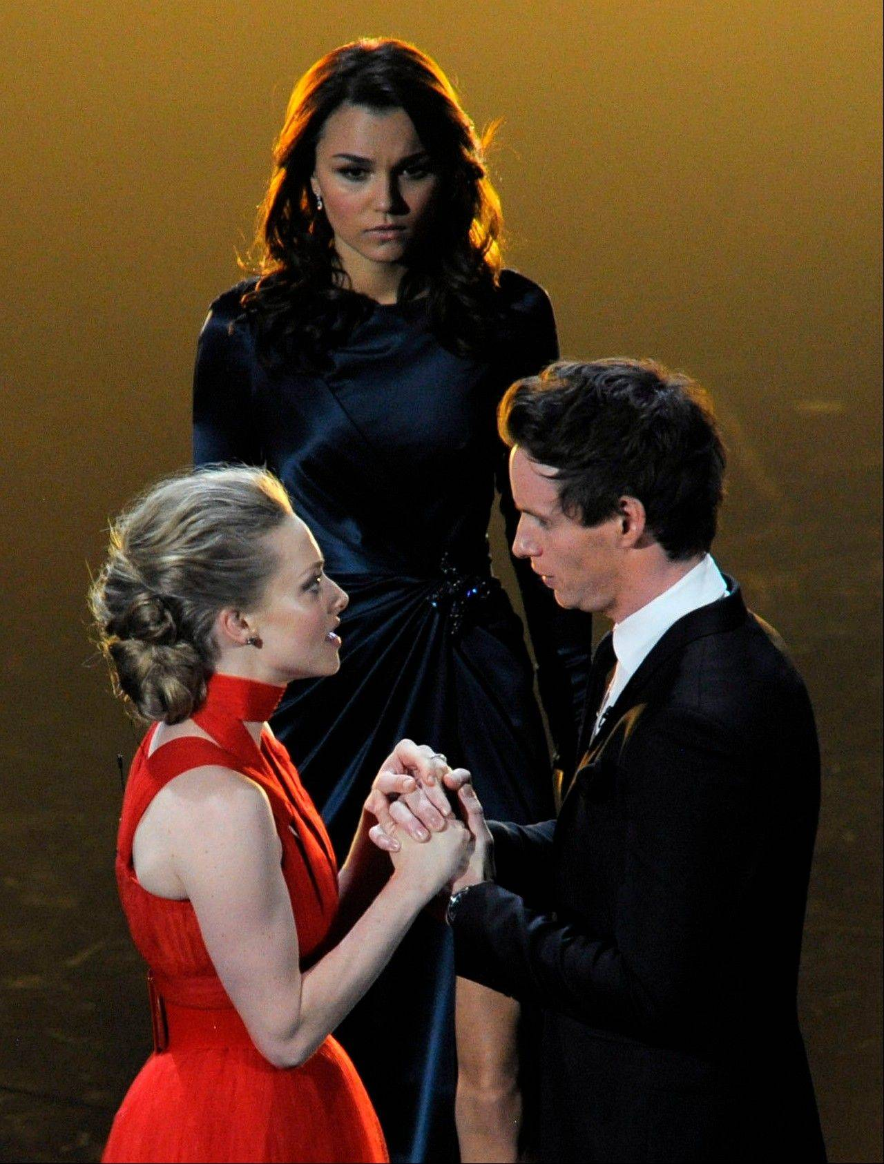 "From left, actors Amanda Seyfried, Samantha Barks and Eddie Redmayne, from the cast of ""Les Miserables,"" perform during Sunday's Oscars."