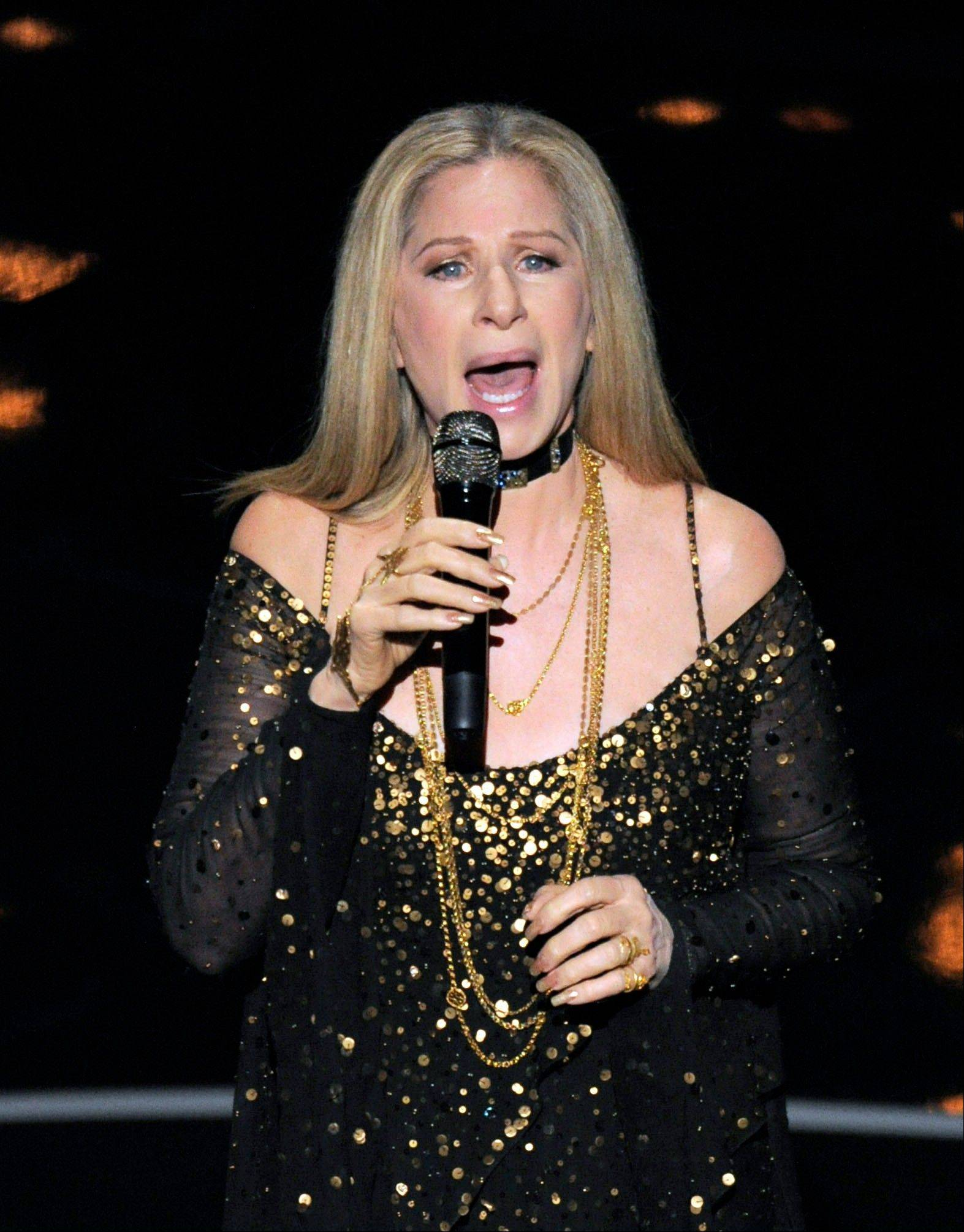 "Barbra Streisand performs ""Memories"" after late composer Marvin Hamlisch's image was shown as part of the ""in memoriam"" segment at Sunday's Oscars."