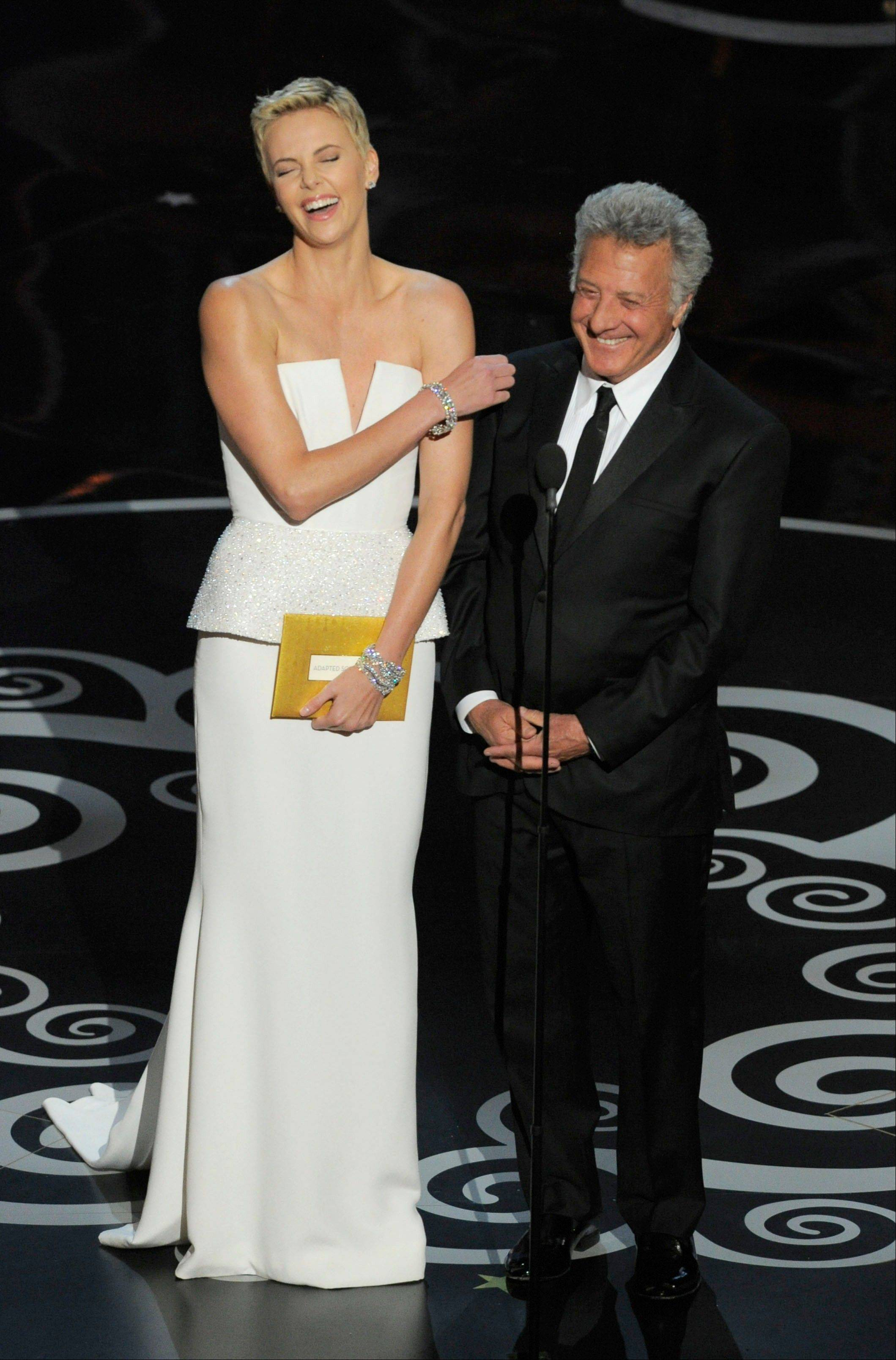 Actors Charlize Theron, left, and Dustin Hoffman present an award during Sunday's Oscars.