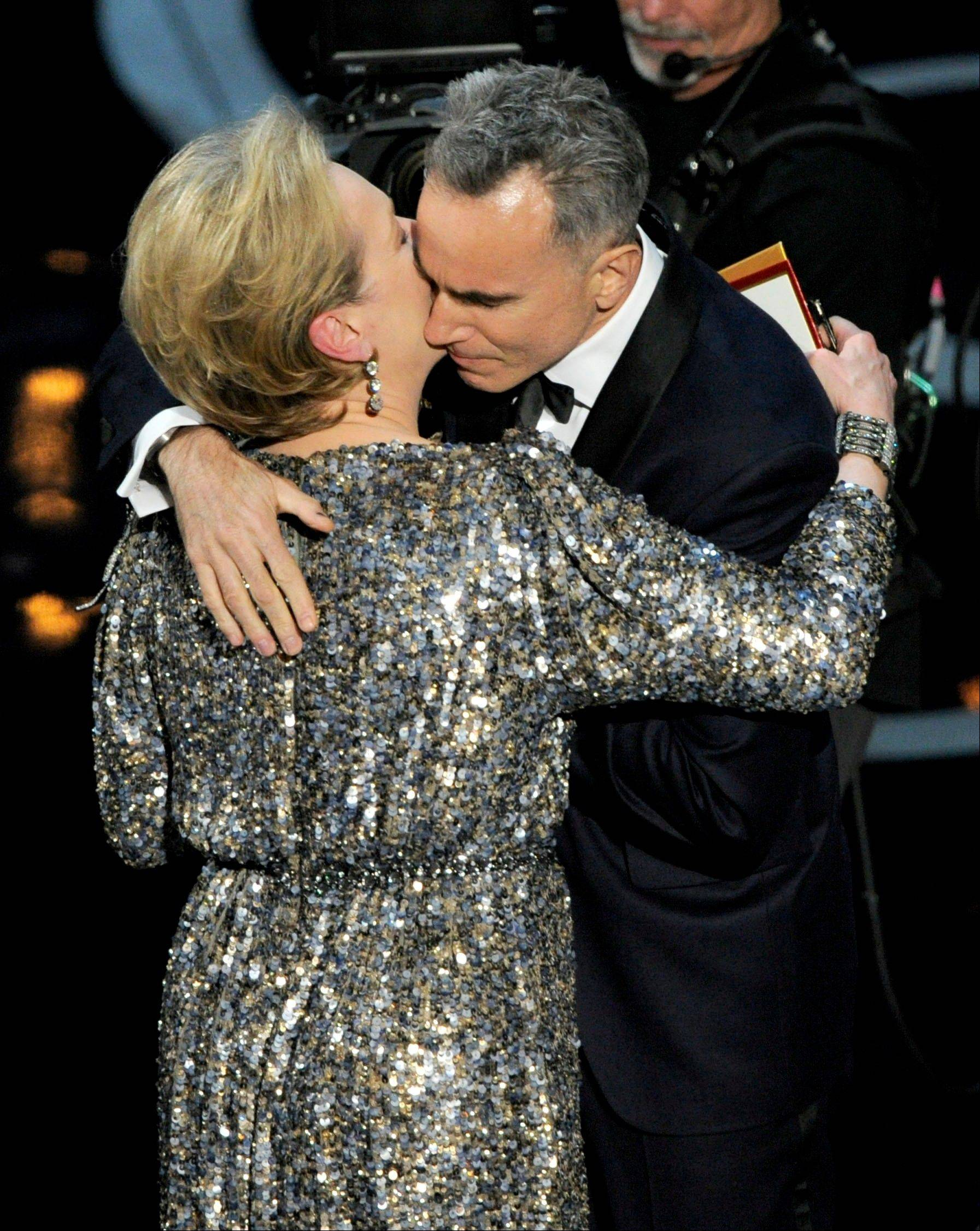 "Meryl Streep, left, presents the award for best actor to Daniel Day-Lewis for ""Lincoln"" during Sunday's Oscars."
