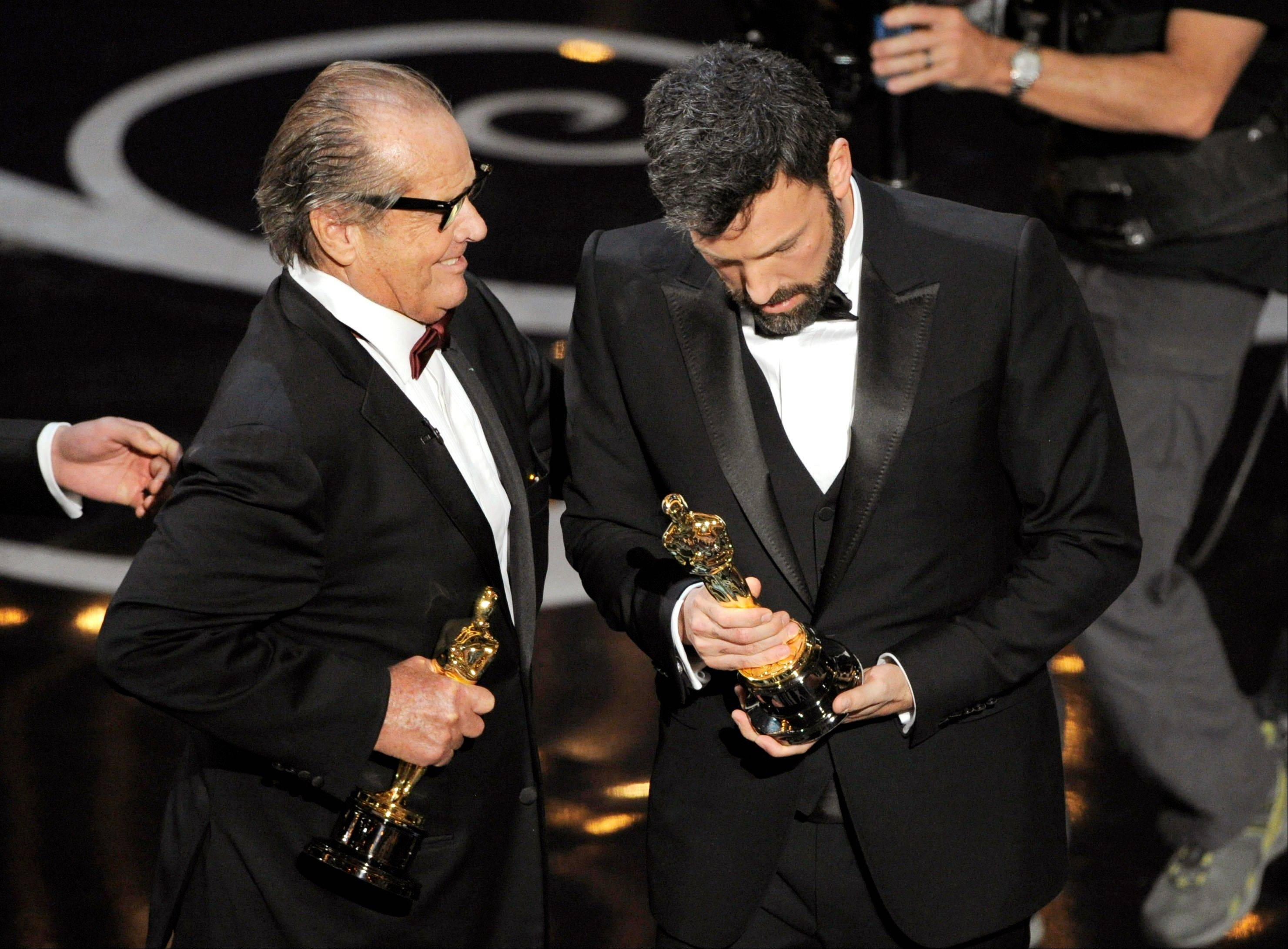 "Actor Jack Nicholson, left, presents the the award for best picture to producer/director Ben Affleck for ""Argo"" during Sunday's Oscars."