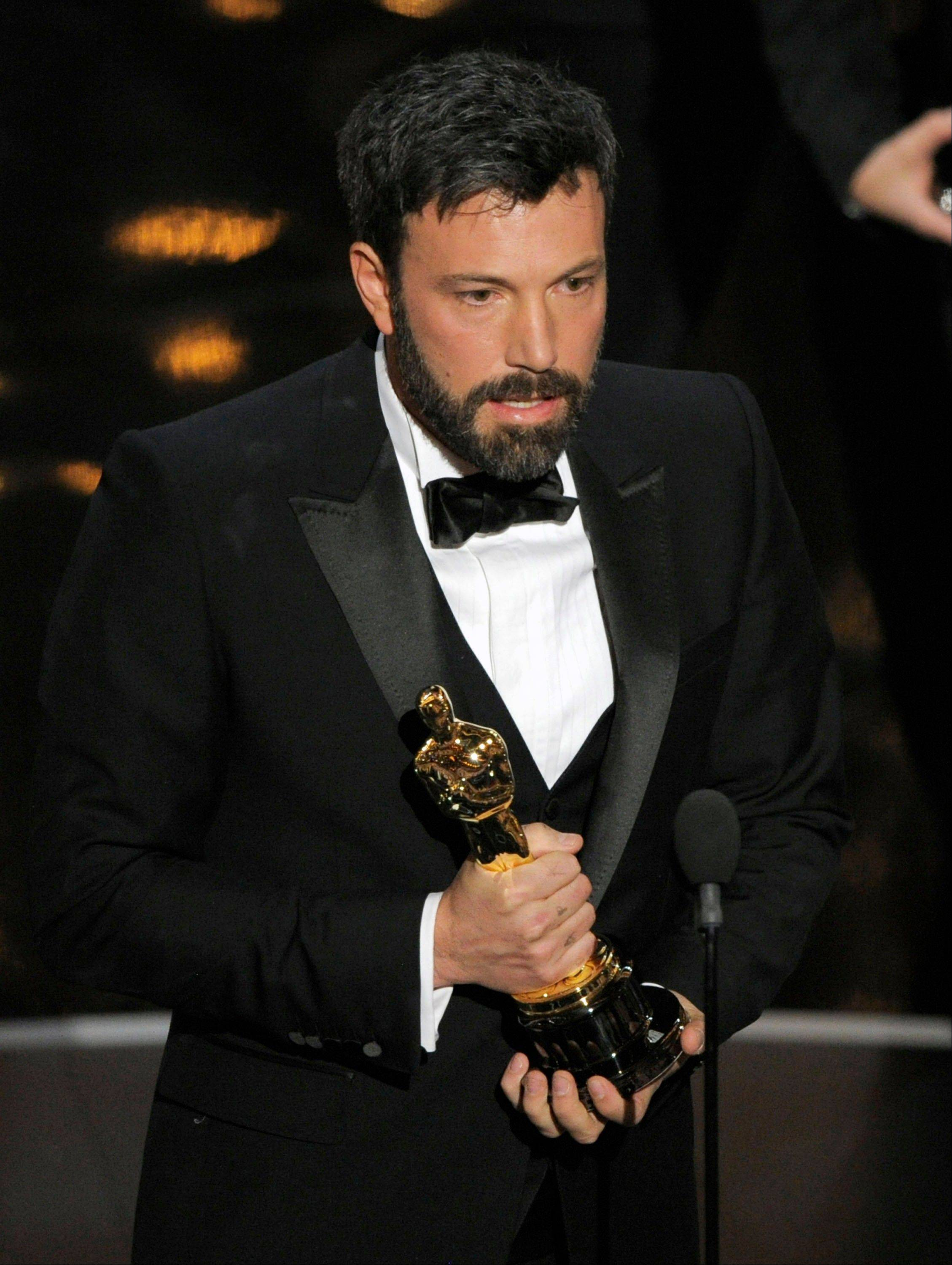 "Director/producer Ben Affleck accepts the award for best picture for ""Argo"" during Sunday's Oscars."