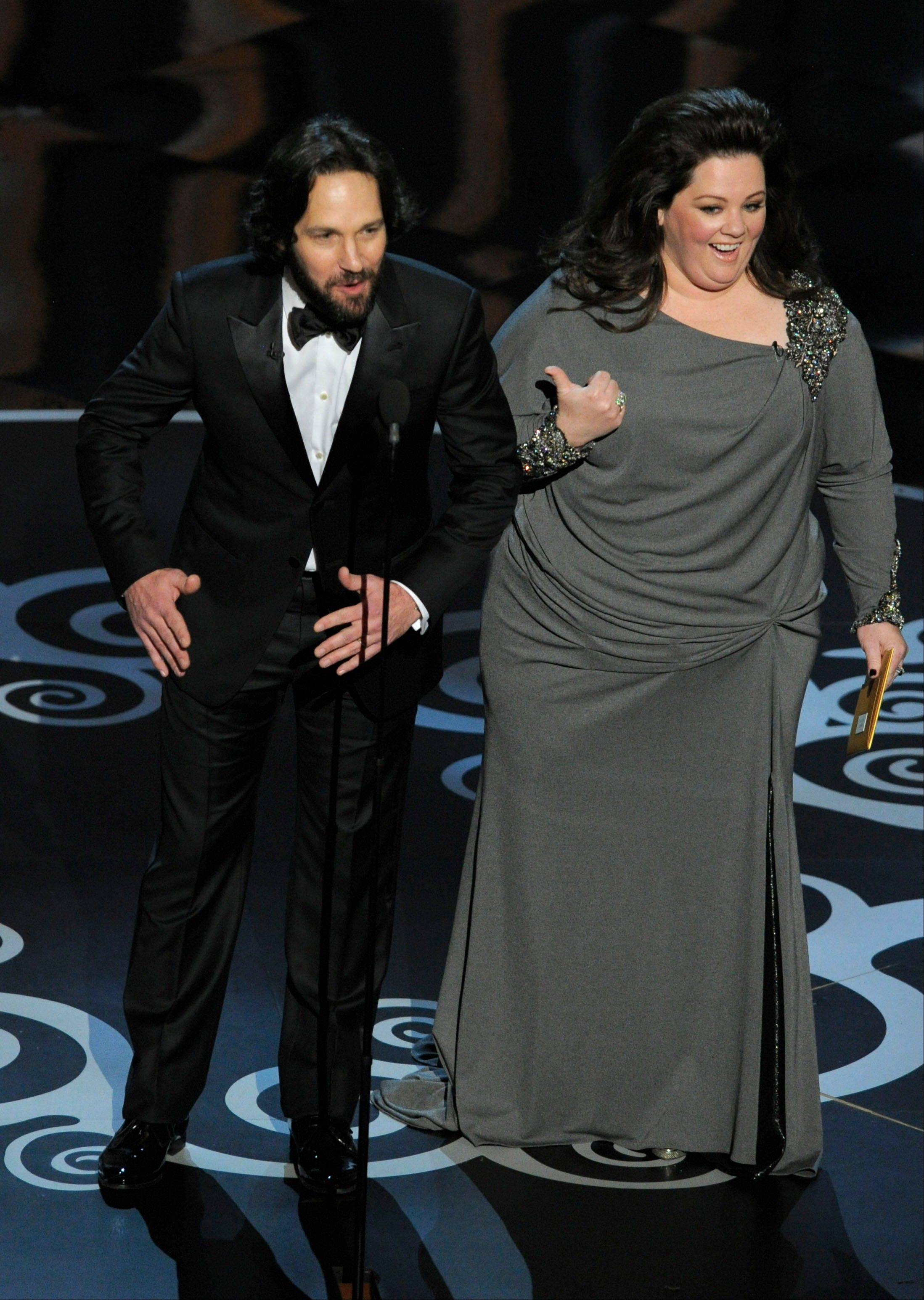 Actors Paul Rudd, left, and Melissa McCarthy present the animation awards at Sunday's Oscars.