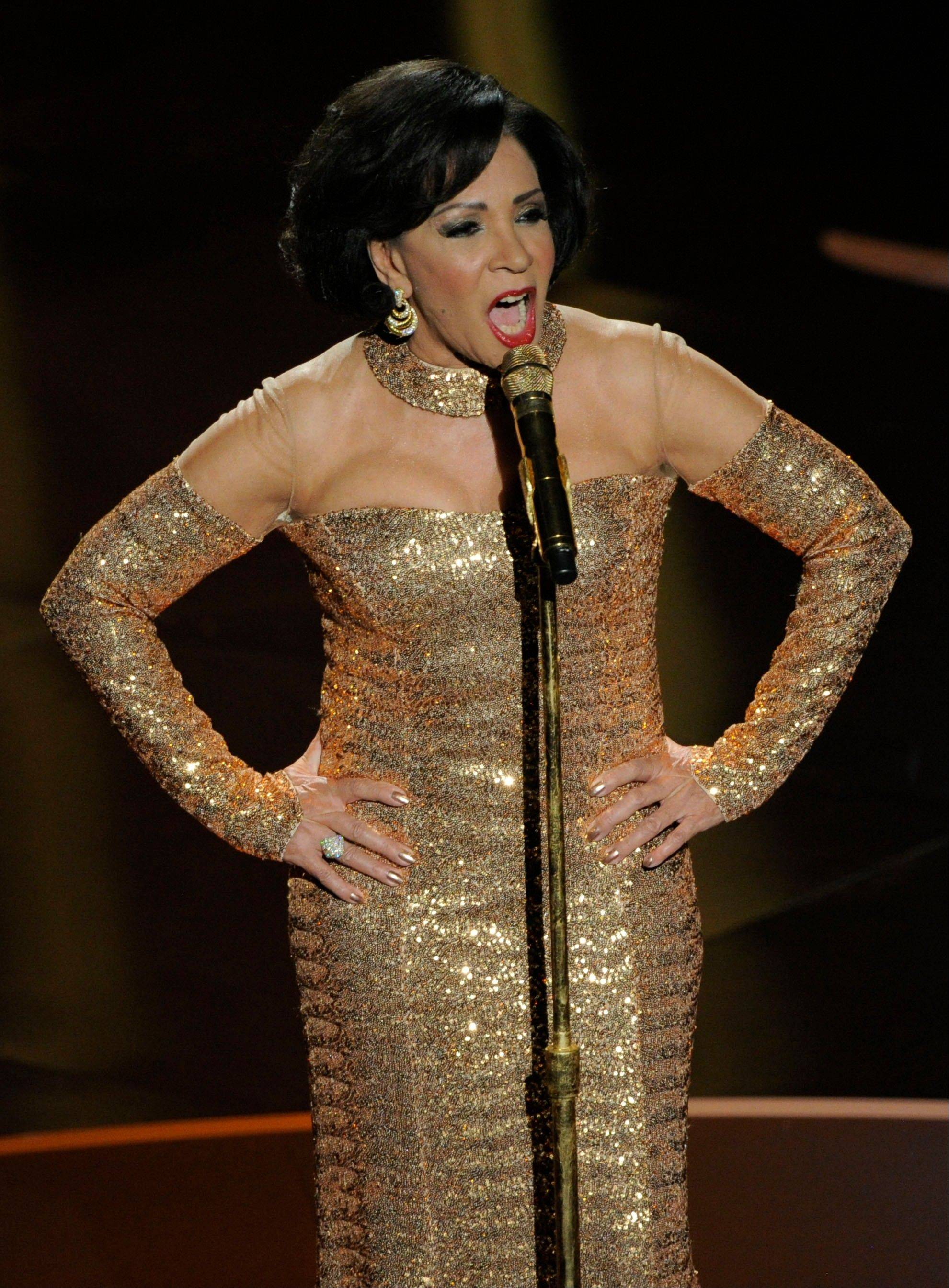 "Singer Shirley Bassey performs her signature James Bond theme, ""Goldfinger,"" during Sunday's OScars."