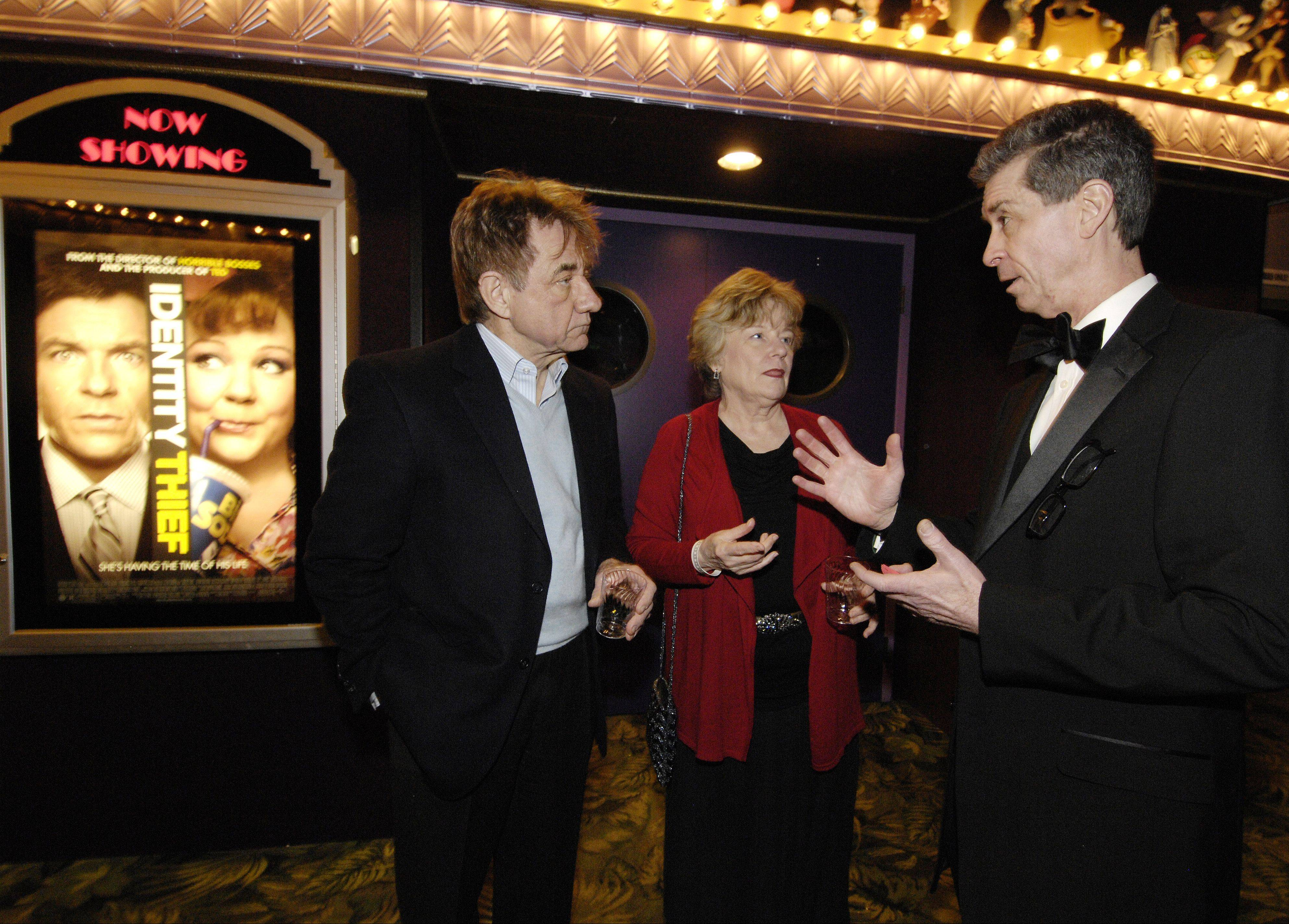 Daily Herald subscribers Bob and Patti Jostes of Arlington Heights talk with Daily Herald Film Critic Dann Gire during Sunday's Oscars event at the Hollywood Palms Cinema in Naperville.