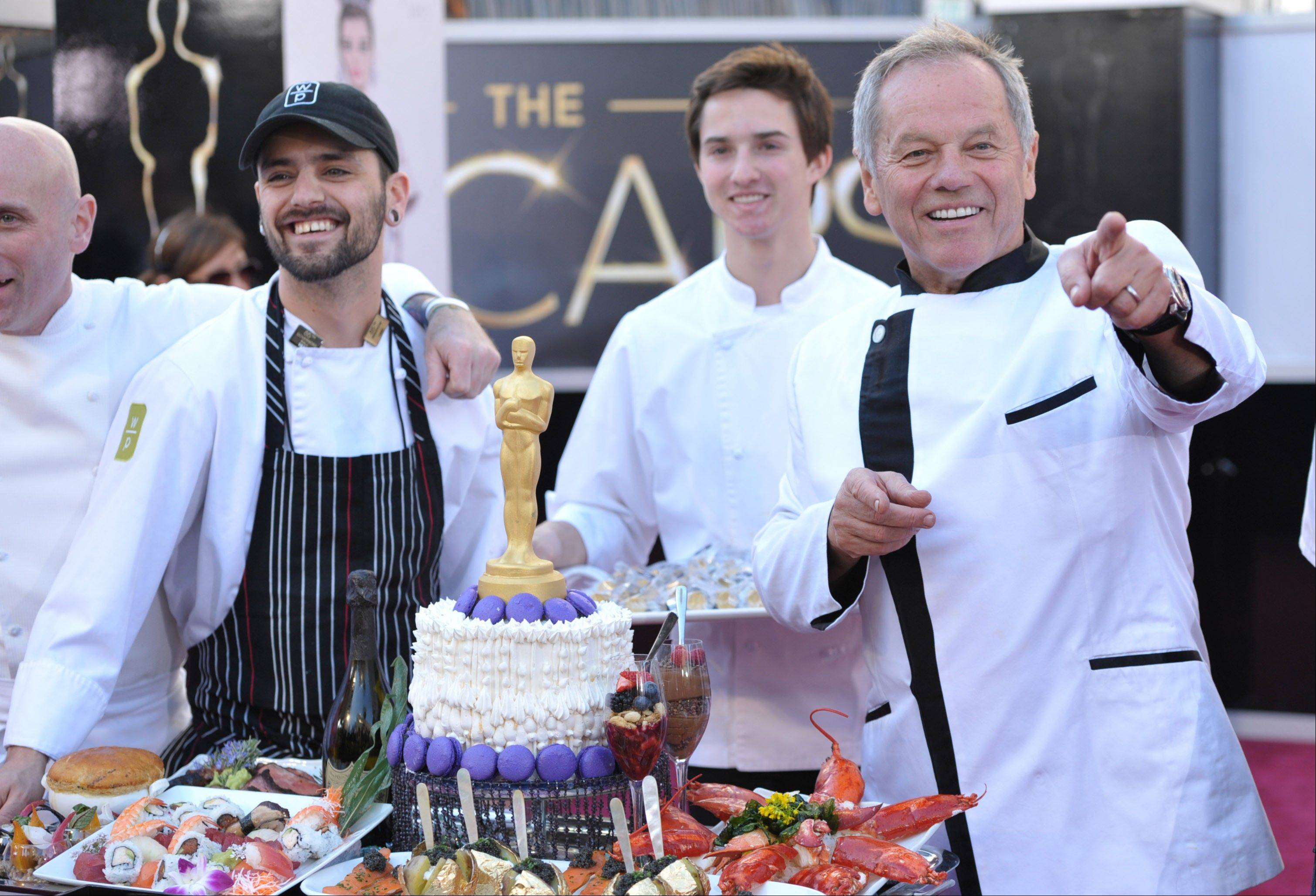 Celebrity chef Wolfgang Puck displays a platter of food the 85th Academy Awards at the Dolby Theatre on Sunday in Los Angeles.