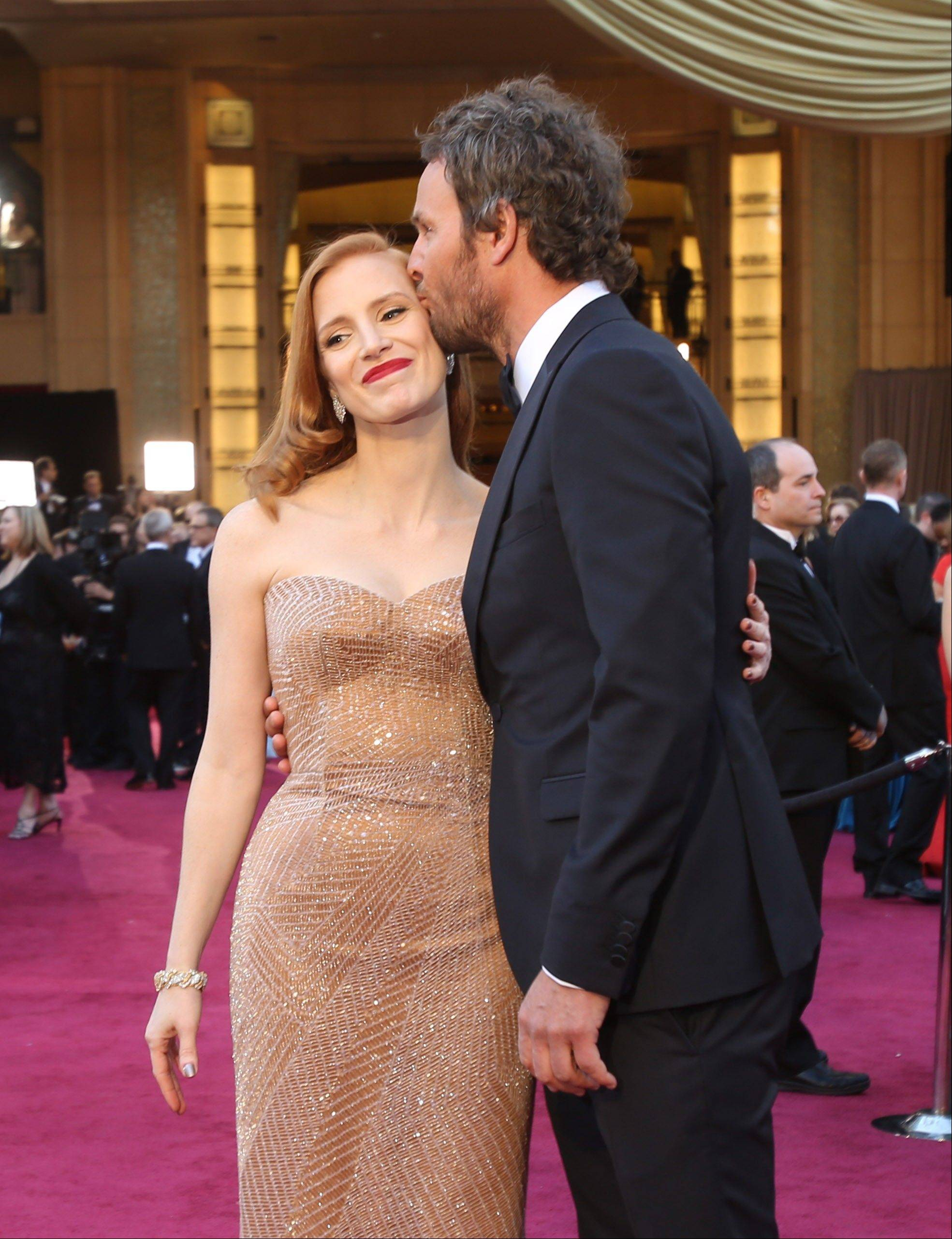 Actor Jason Clarke kisses actress Jessica Chastain.