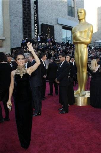 Actress Salma Hayek gives fans some love before heading into the theater.