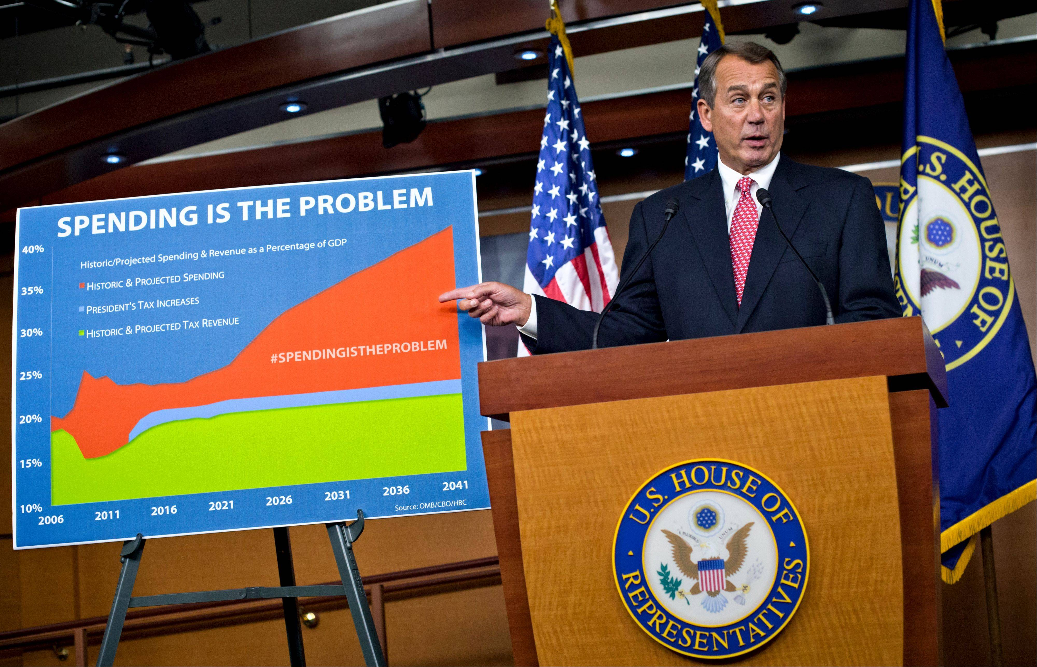 House Speaker John Boehner accuses President Barack Obama of not being serious about cutting government spending during a Capitol Hill news conference in Washington on Dec. 13. Lawmakers and the president are on the brink of yet another compromise-or-else deadline Friday.