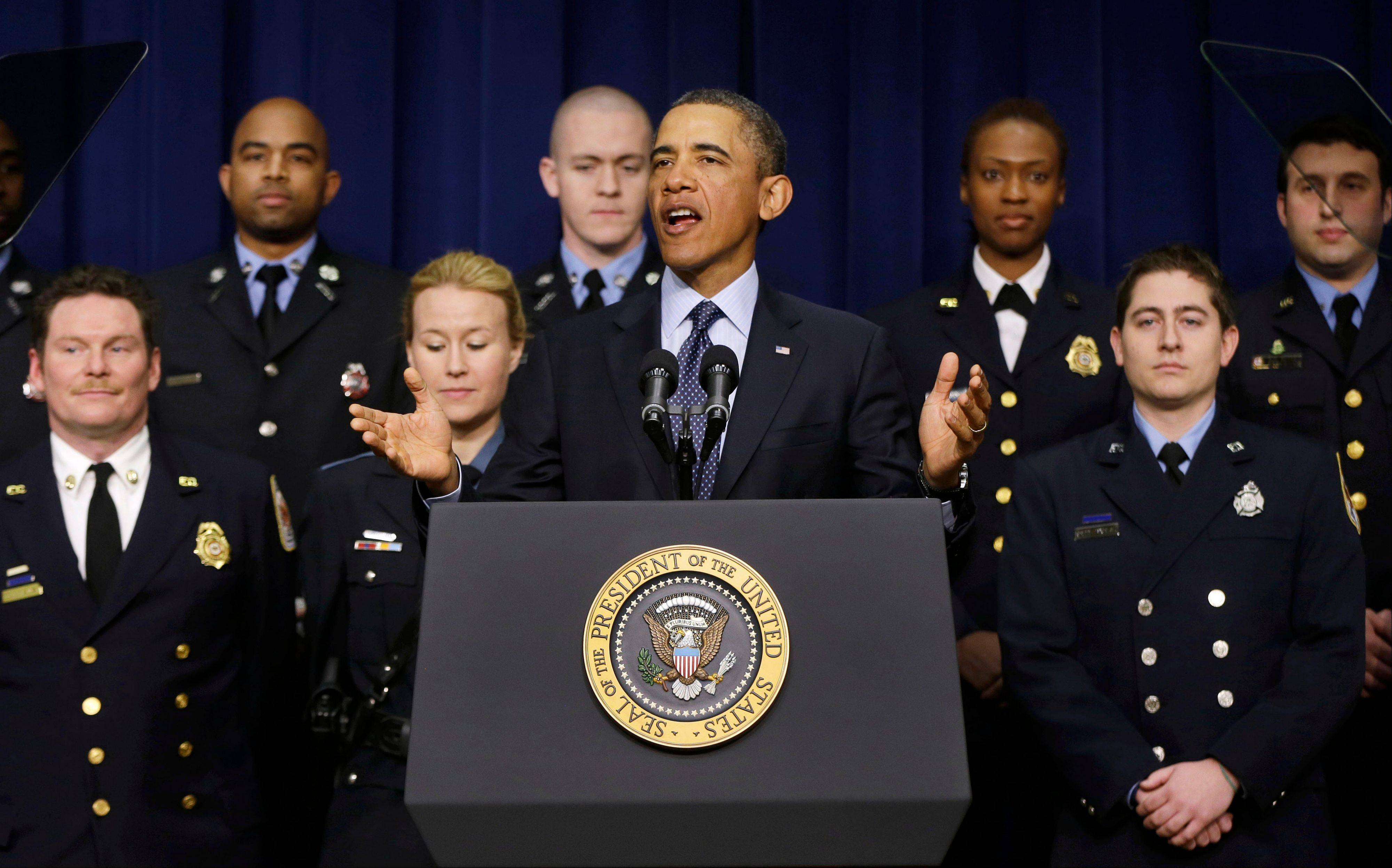 President Barack Obama talks about sequestration on Feb. 19, accompanied on stage by emergency responders, a group of workers the White House says could be affected if state and local governments lose federal money as a result of budget cuts. Lawmakers and the president are on the brink of yet another compromise-or-else deadline Friday.