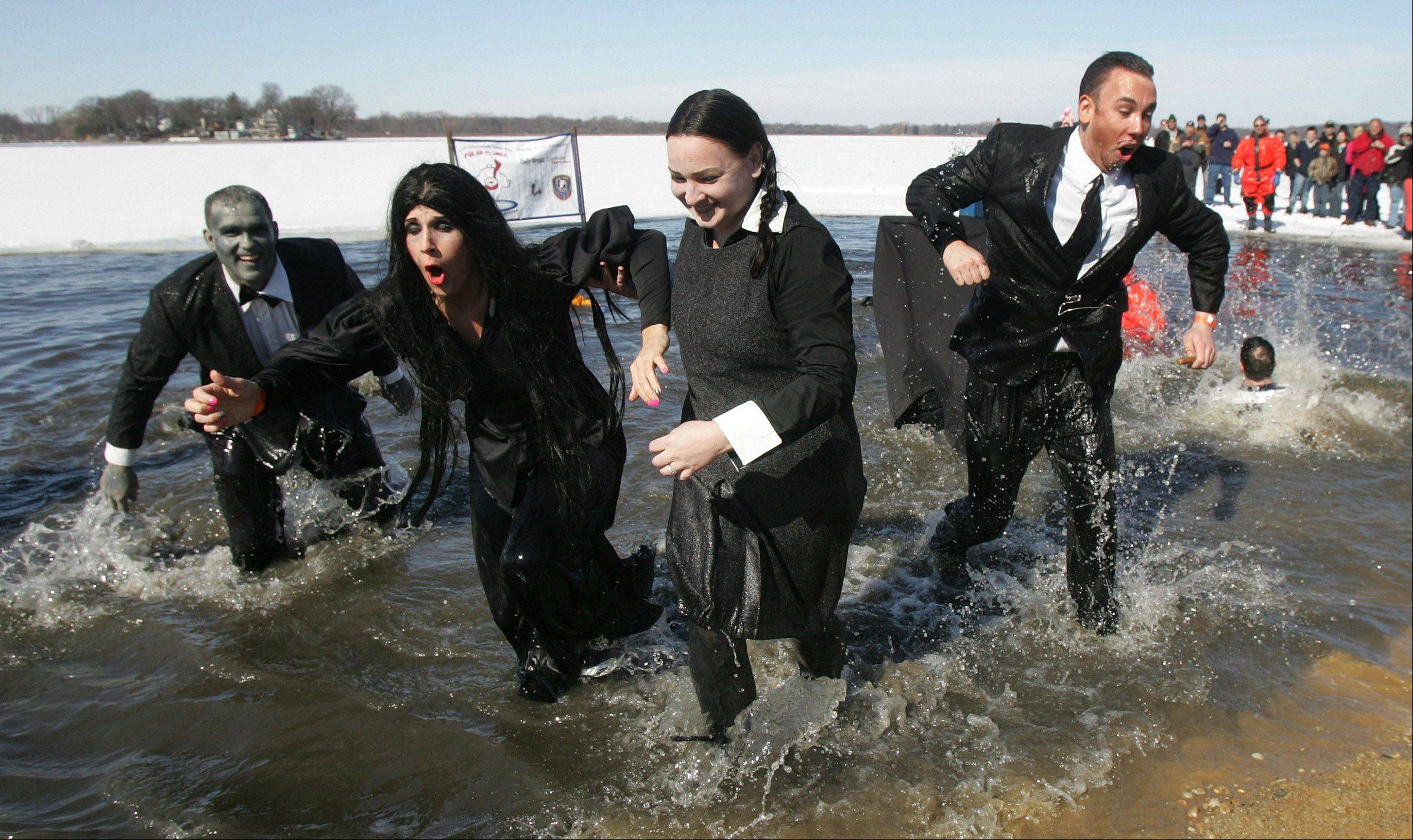 Members of the Grayslake Police Department dressed as the Addams Family as they run out of the cold lake during the annual Fox Lake Polar Plunge Sunday at Lakefront Park. The funds raised will benefit Special Olympics Illinois Northeastern/Area 13, which serves athletes with physical and intellectual disabilities in Lake and McHenry counties.
