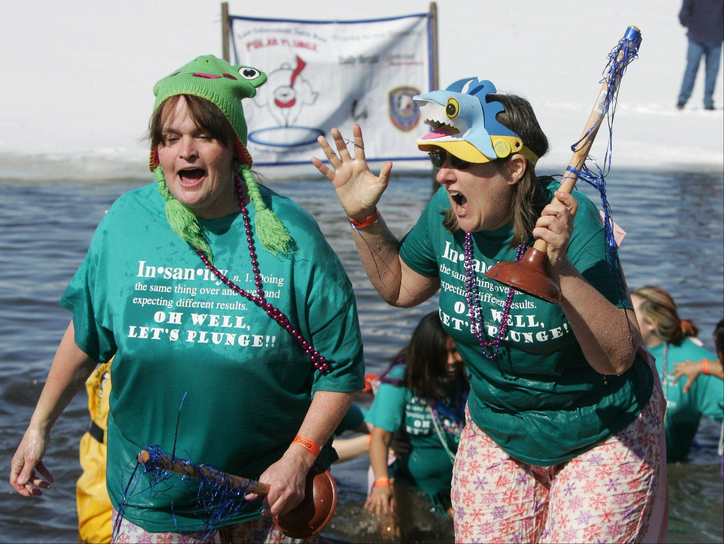 Candi Blake, left, and Kathy Gorman, of McHenry, scream after coming out of the frigid water during the annual Fox Lake Polar Plunge Sunday at Lakefront Park. The funds raised will benefit Special Olympics Illinois Northeastern/Area 13, which serves athletes with physical and intellectual disabilities in Lake and McHenry counties.