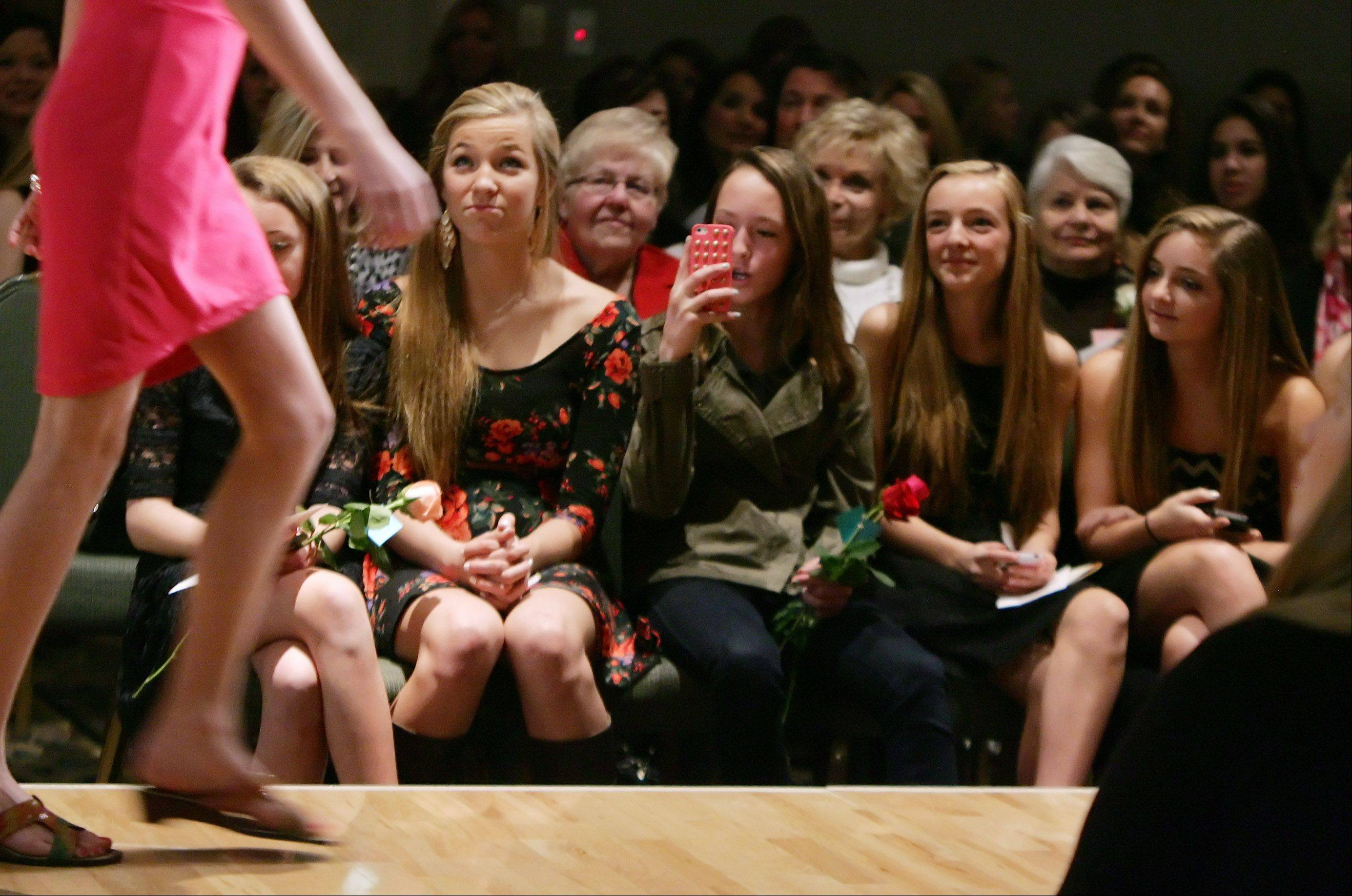 "The audience watches as a model walks down the runway Sunday during the first student-run charity fashion show, ""Hope's In Style,"" at the Garland's Center for the Performing Arts in Barrington. The fashion show raised funds for a Guatemalan family living near a garbage dump in Guatemala City."