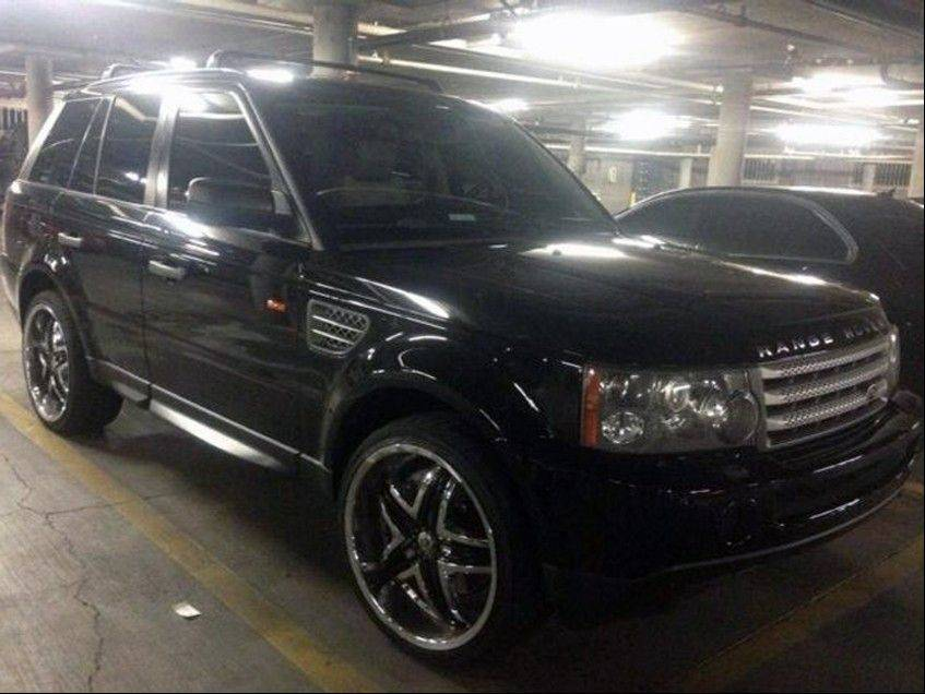 This photo provided by the Las Vegas Metropolitan Police Department shows a black Range Rover SUV in Las Vegas that was found Saturday at an apartment complex east of the Las Vegas Strip. It has been impounded as evidence in connection with a shooting that sent a Maserati into a taxi that exploded, killing three people.