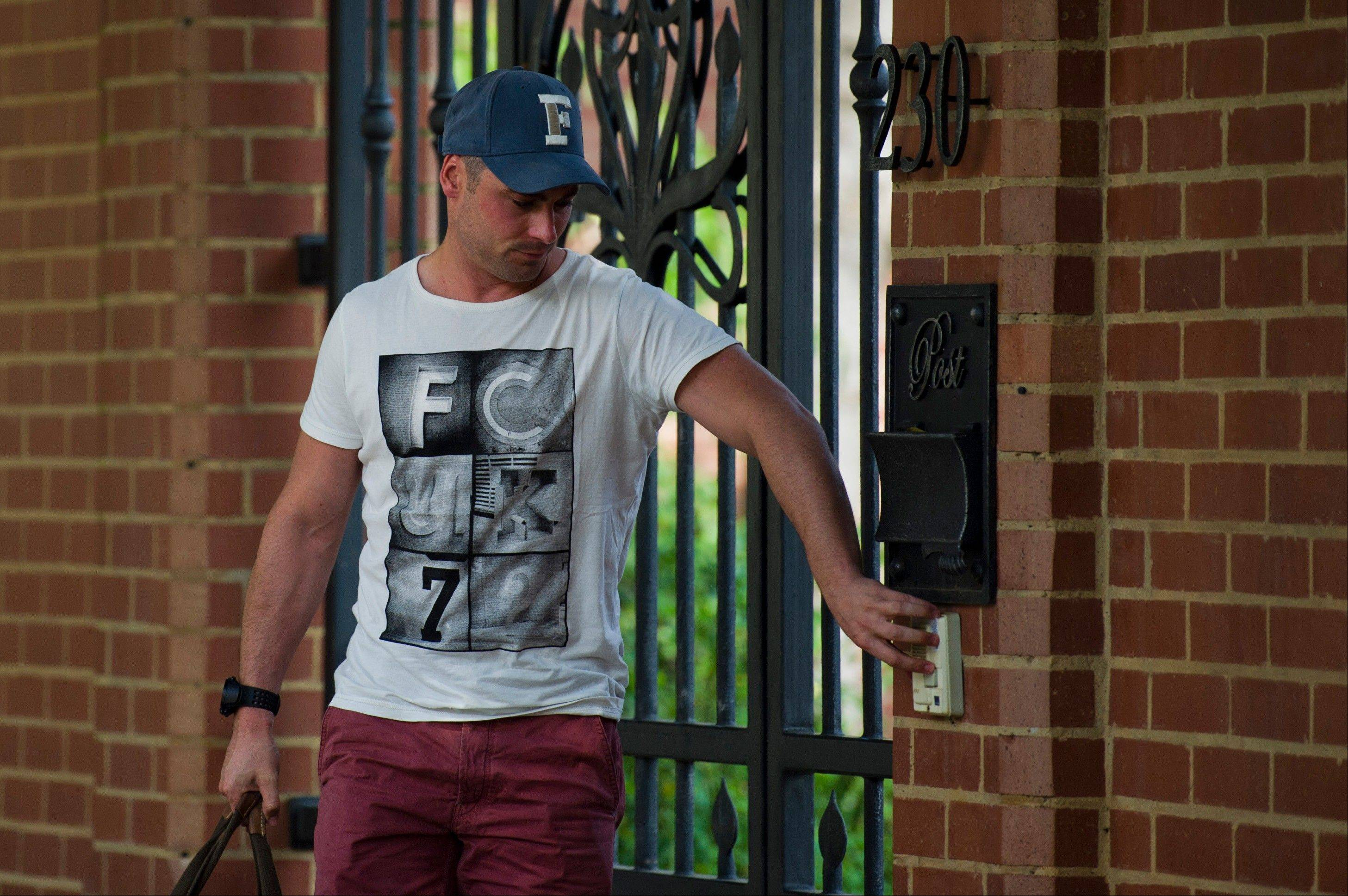 Carl Pistorius, brother of Olympian athlete, Oscar Pistorius, arrives home Sunday, where his brother has been staying in Pretoria, South Africa, since being granted bail Friday for the Valentine's Day shooting death of his girlfriend.