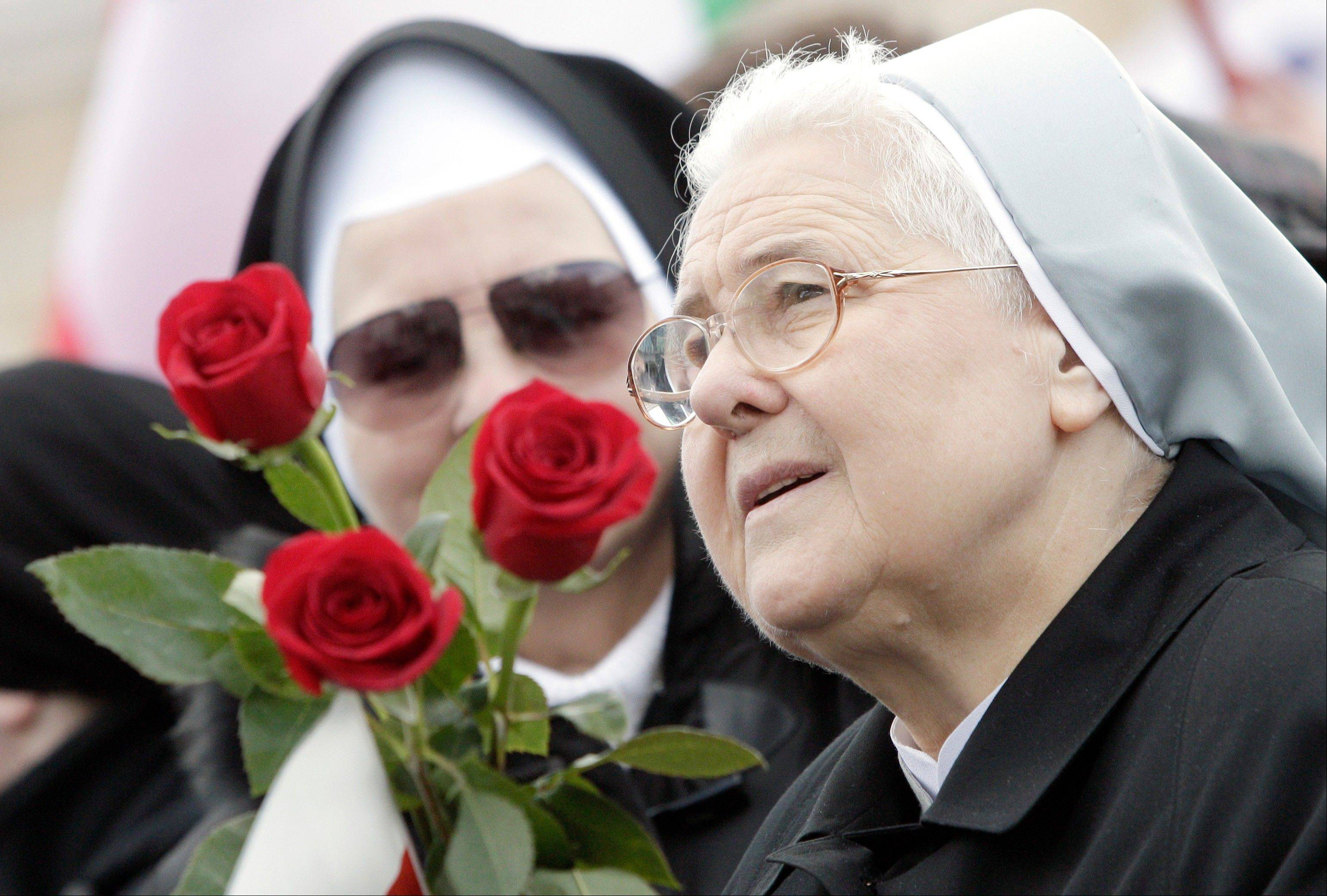 Nuns attend Pope Benedict XVI's last Angelus prayer, in St. Peter's Square, at the Vatican, Sunday.