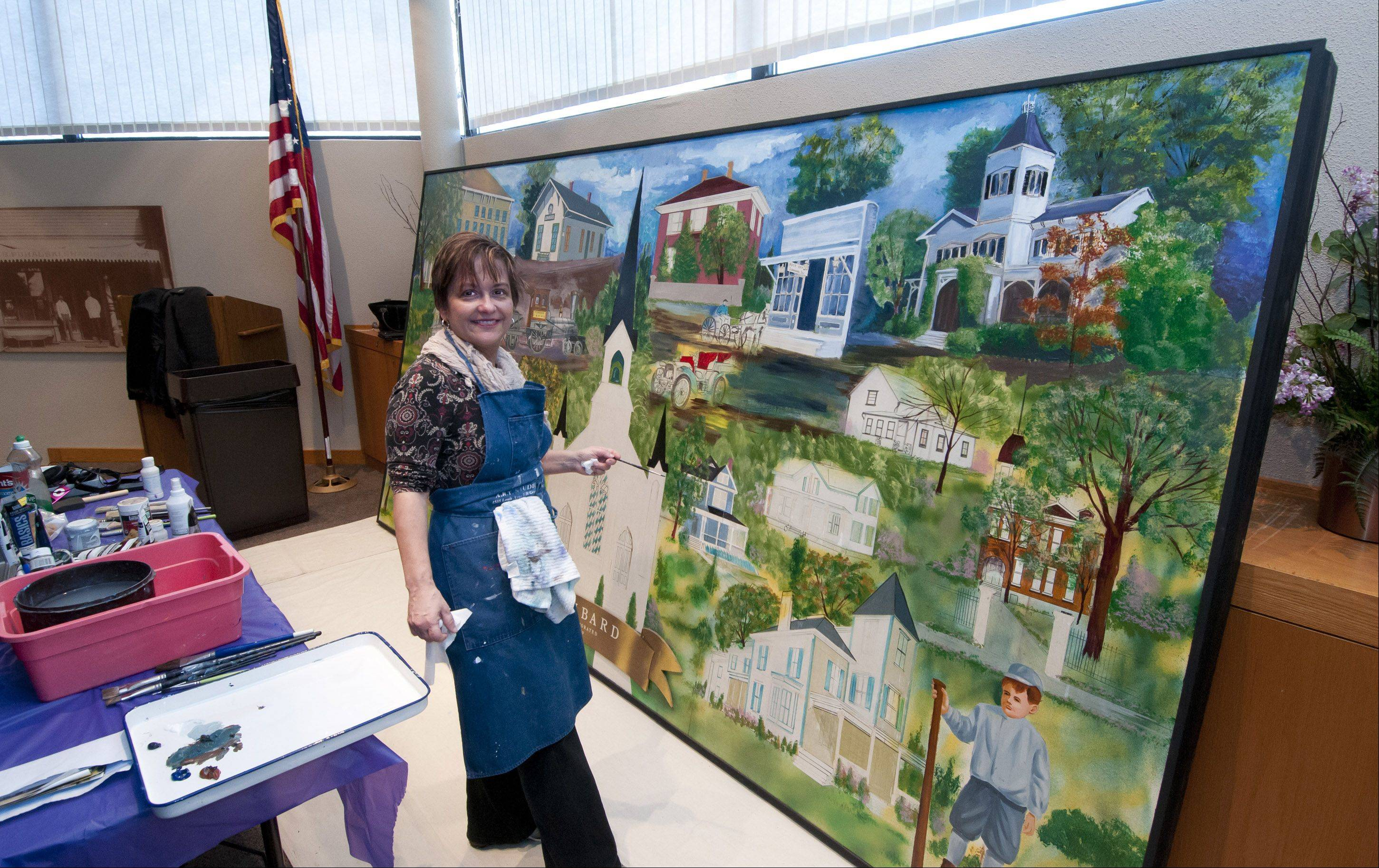 Lombard Trustee Laura Fitzpatrick has spent more than 30 hours working to finish this painting of historic sites in Lombard by the late muralist Vern Milem. Her work has drawn criticism from Brian Diskin of Wheaton, a freelance cartoonist who teaches at the College of DuPage.