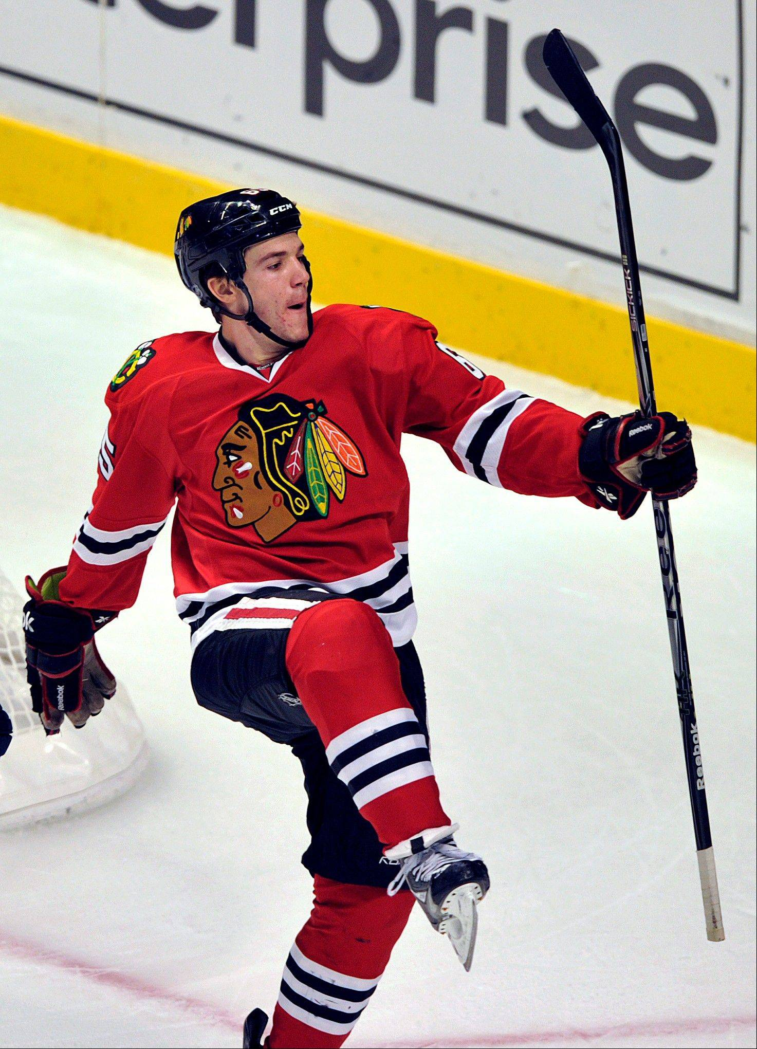 Andrew Shaw celebrates the only goal of the game Sunday night at the United Center. Shaw's fourth goal of the season gave the Hawks a 1-0 victory.