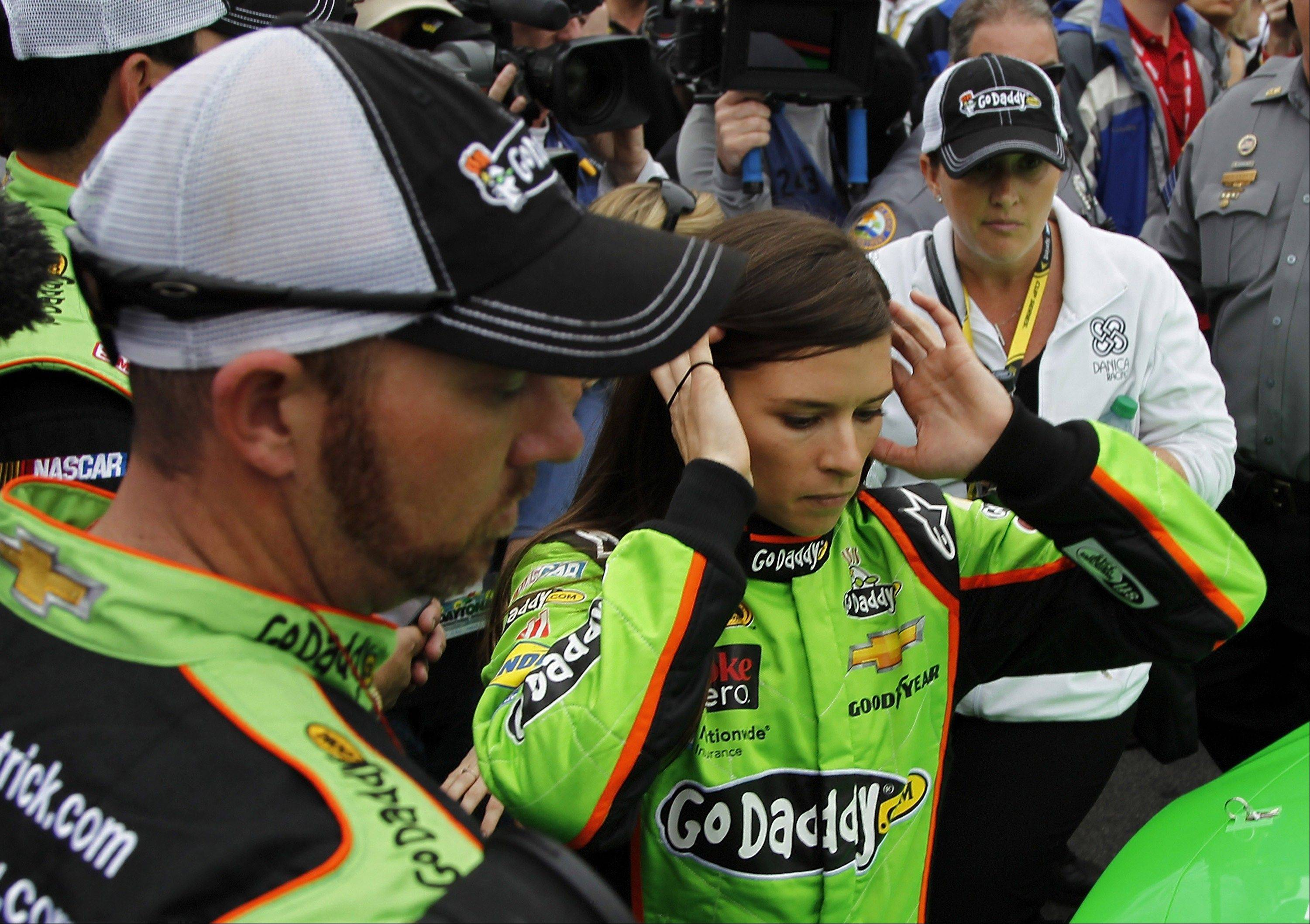 Danica Patrick prepares to get in her car before the start of the Daytona 500 at Daytona International Speedway on Sunday in Daytona Beach, Fla.
