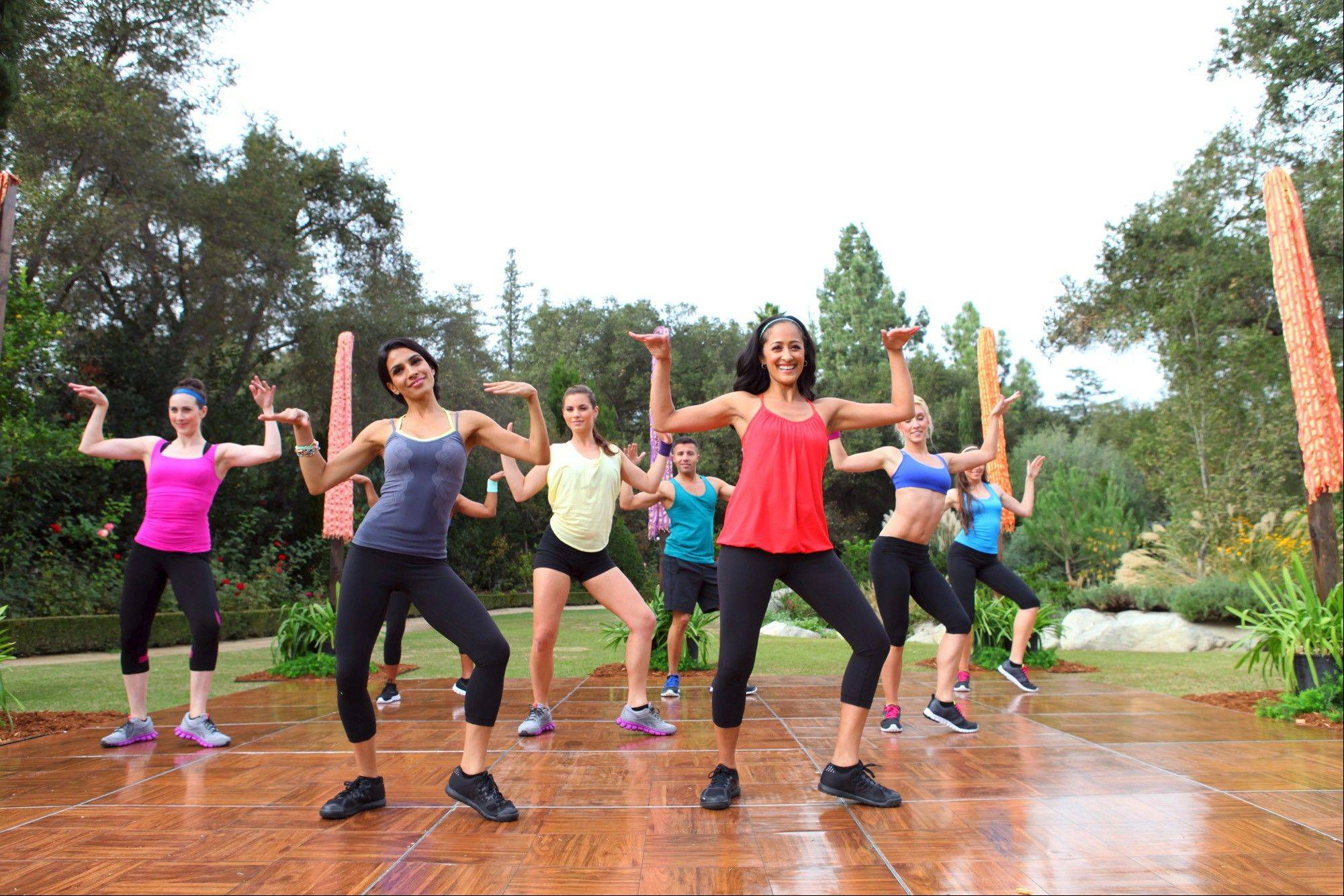 Co-founders Kajal Desai (in the red shirt) and Priya Pandya (in the gray shirt) lead a class on one of their new DVDs.