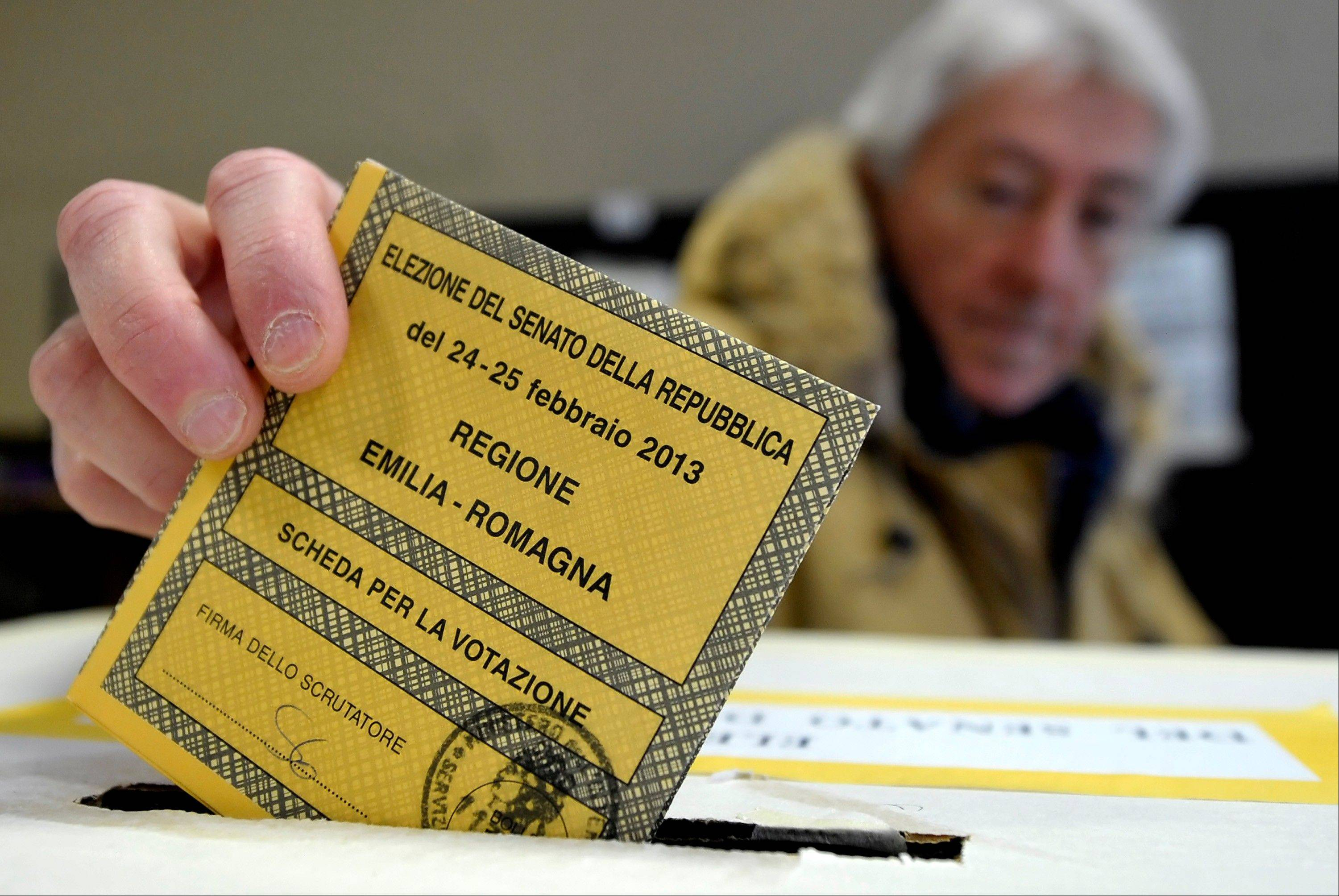 A man casts his vote for the Italian Senate in Piacenza, Italy, Sunday. Italy votes in a watershed parliamentary election Sunday and Monday that could shape the future of one of Europe�s biggest economies.