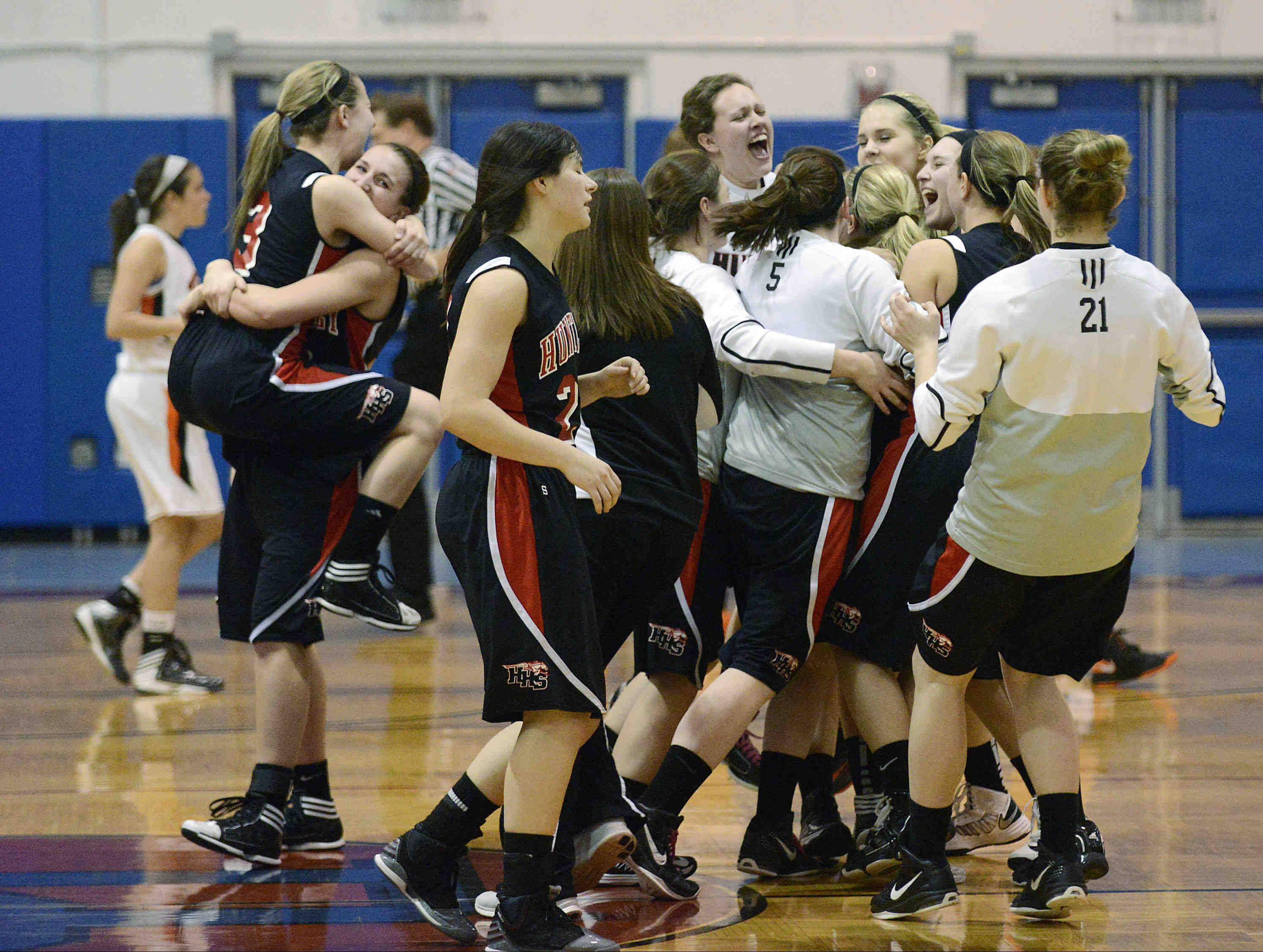 Huntley celebrates its Class 4A Dundee-Crown supersectional win Monday over Wheaton Warrenville South in Carpentersville.