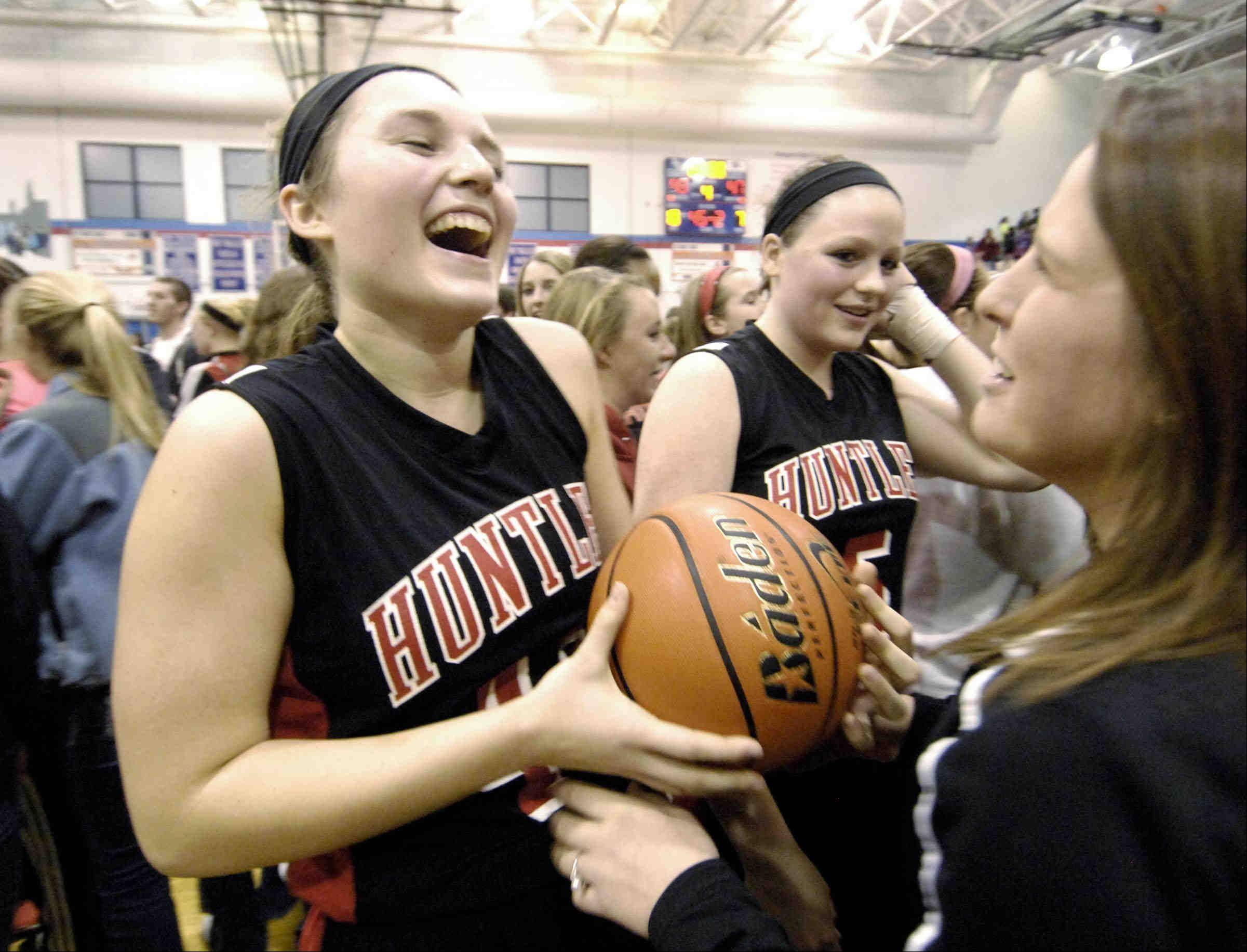 Huntley�s Sam Andrews laughs with the game ball after defeating Wheaton Warrenville South.