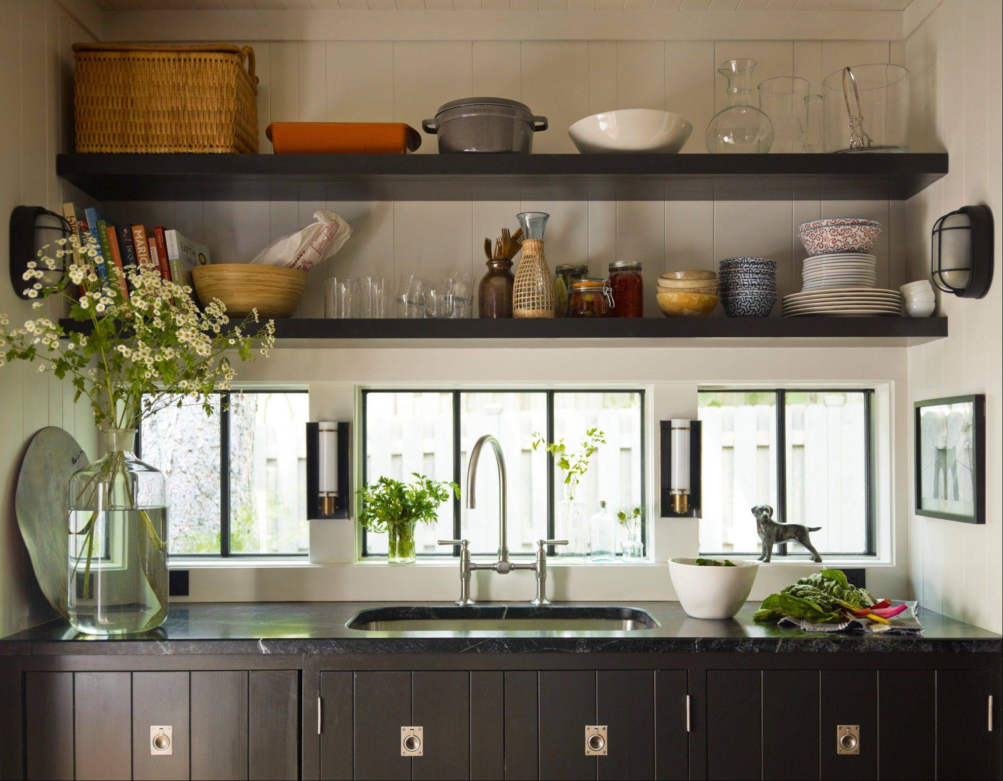 The view from the kitchen sink is a neighbor's fence, so Thom Filicia made the windows only large enough to bring in light. The faucet is Kohler's HiRise.