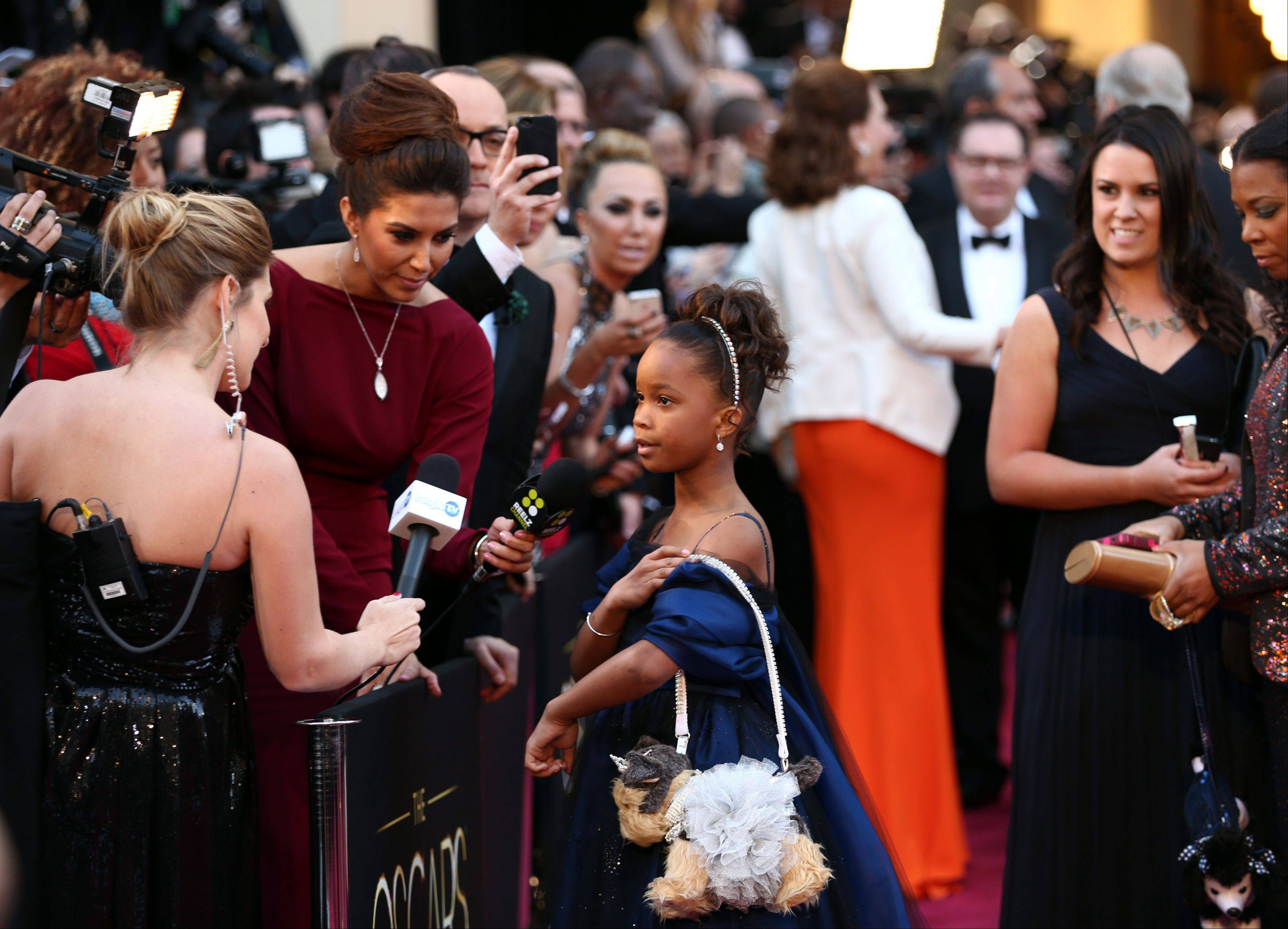 "Actress Quvenzhane Wallis arrives at the Oscars at the Dolby Theatre on Sunday. The Onion is apologizing for calling the 9-year-old star of ""Beasts of the Southern Wild"" a vulgar and offensive name on Twitter, an attack that led to a firestorm online."